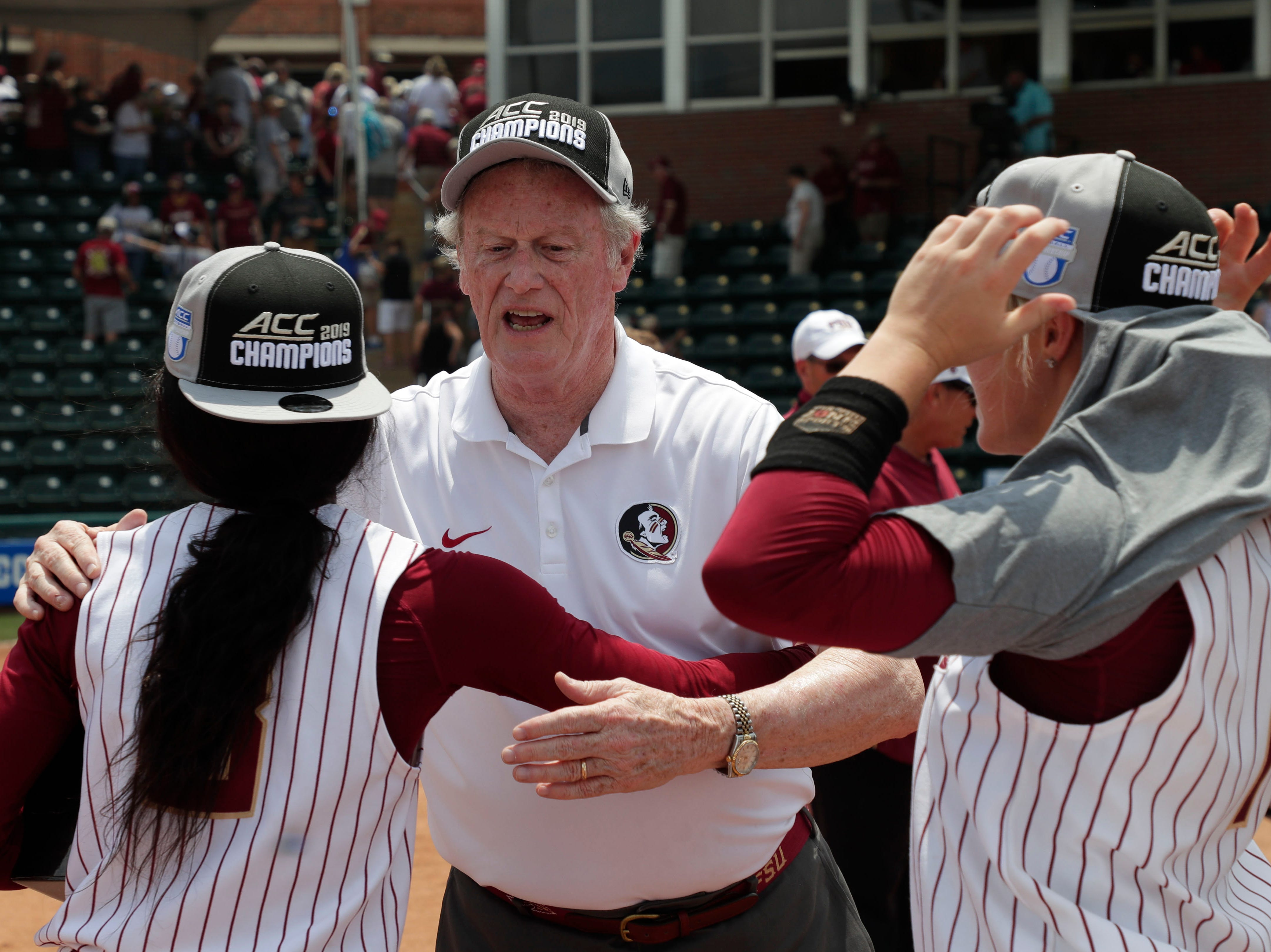 Florida State President John Thrasher hugs the Florida State Seminoles softball players. The Florida State Seminoles celebrate their victory over the UNC Tar Heels for the ACC Softball Championship title Saturday, May 11, 2019.