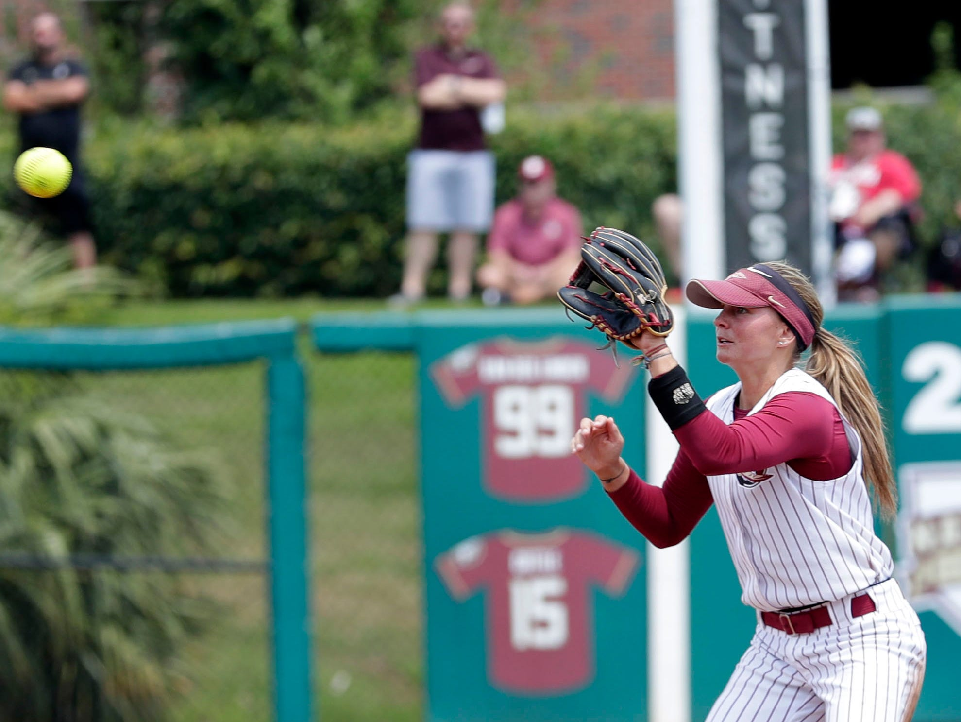 Florida State Seminoles infielder Cali Harrod (10) catches a throw from Florida State Seminoles utility player Sydney Sherrill (24) to get the out at second base. The Florida State Seminoles host the UNC Tar Heels for the ACC Softball Tournament finals Saturday, May 11, 2019.