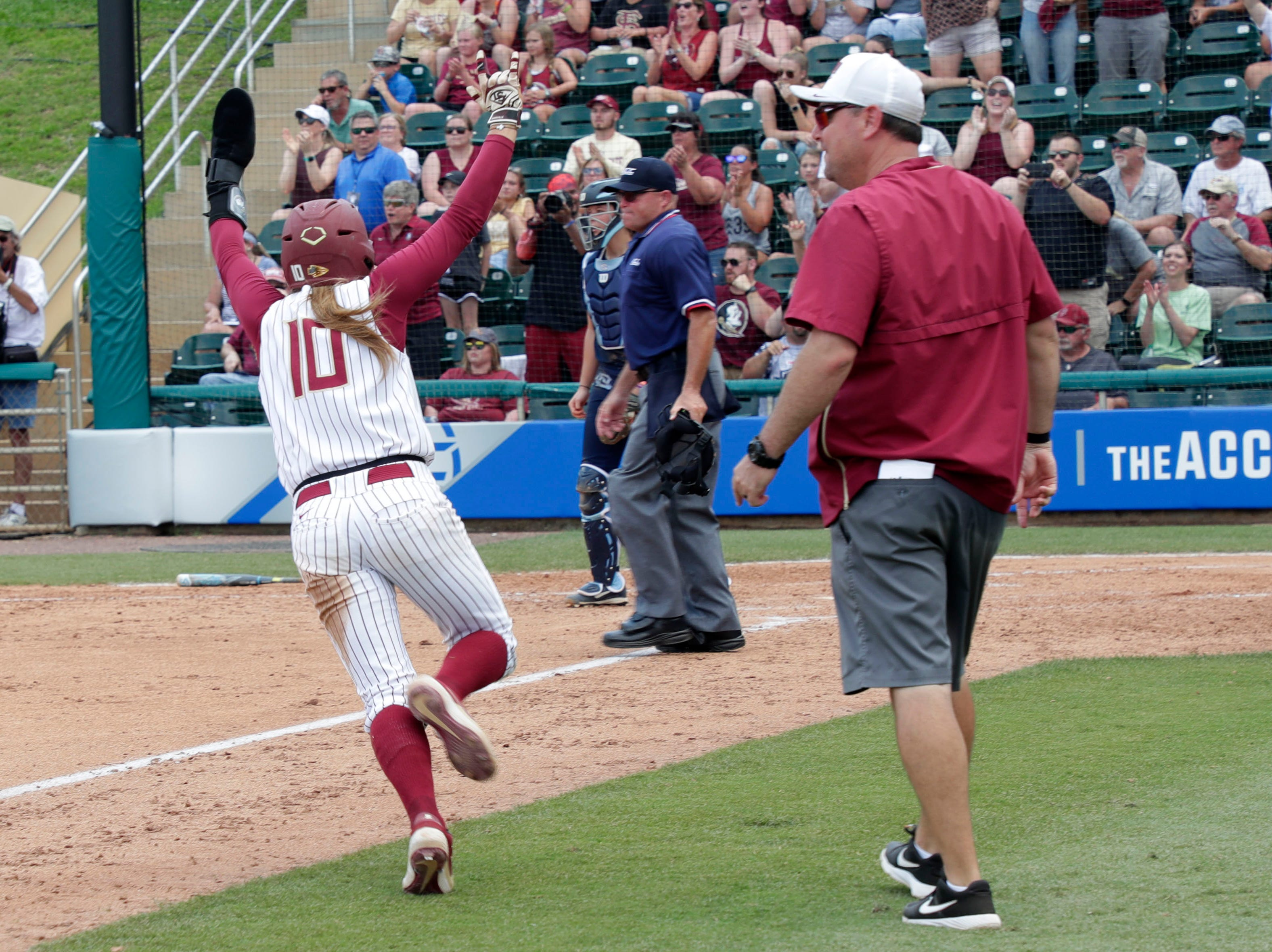 Florida State Seminoles infielder Cali Harrod (10) runs in celebrating her team's victory. The Florida State Seminoles host the UNC Tar Heels for the ACC Softball Tournament finals Saturday, May 11, 2019.