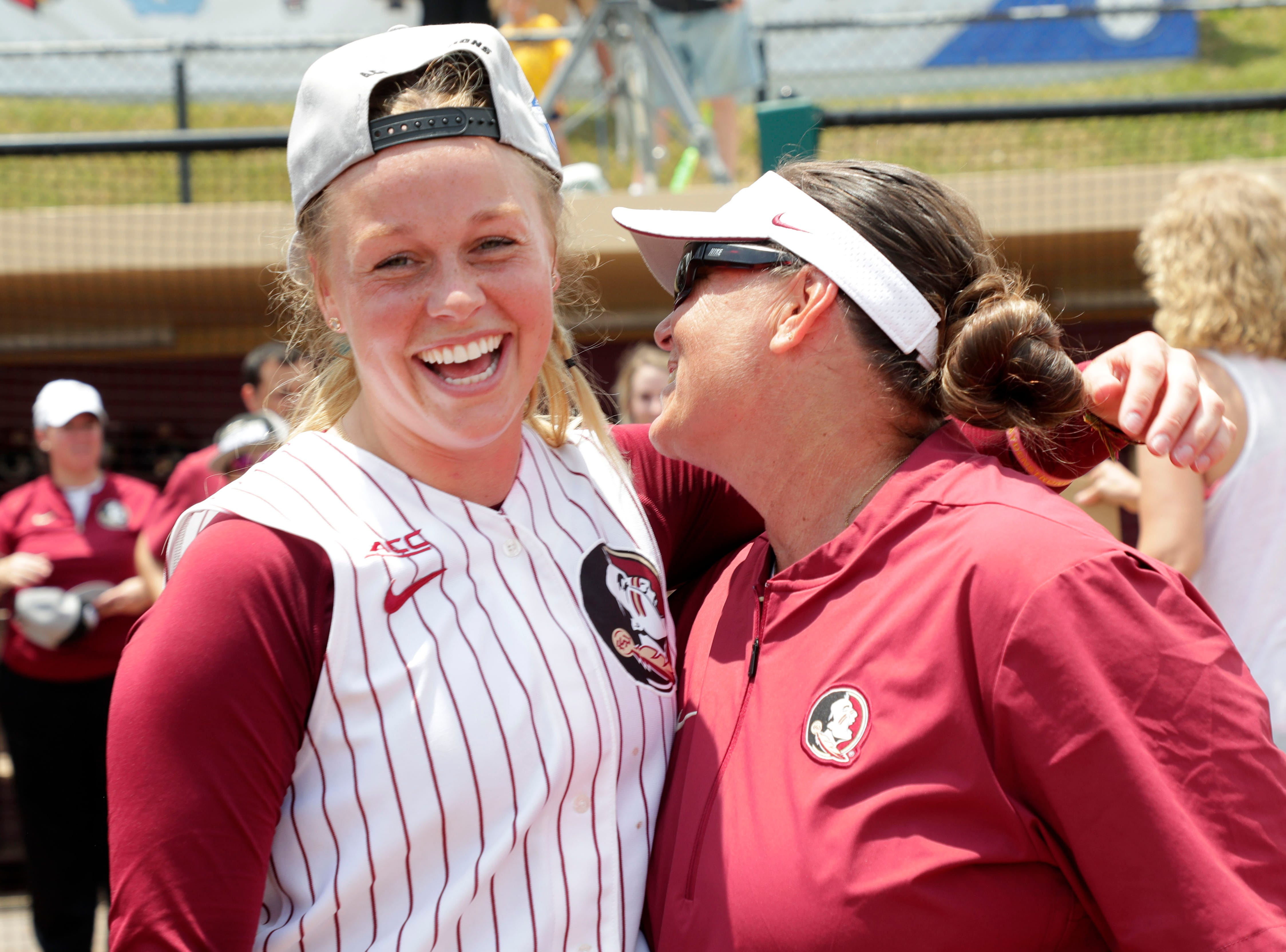 Florida State Seminoles starting pitcher/relief pitcher Meghan King (48) and head coach Lonni Alameda  hug after a hard fought victory. The Florida State Seminoles celebrate their victory over the UNC Tar Heels for the ACC Softball Championship title Saturday, May 11, 2019.