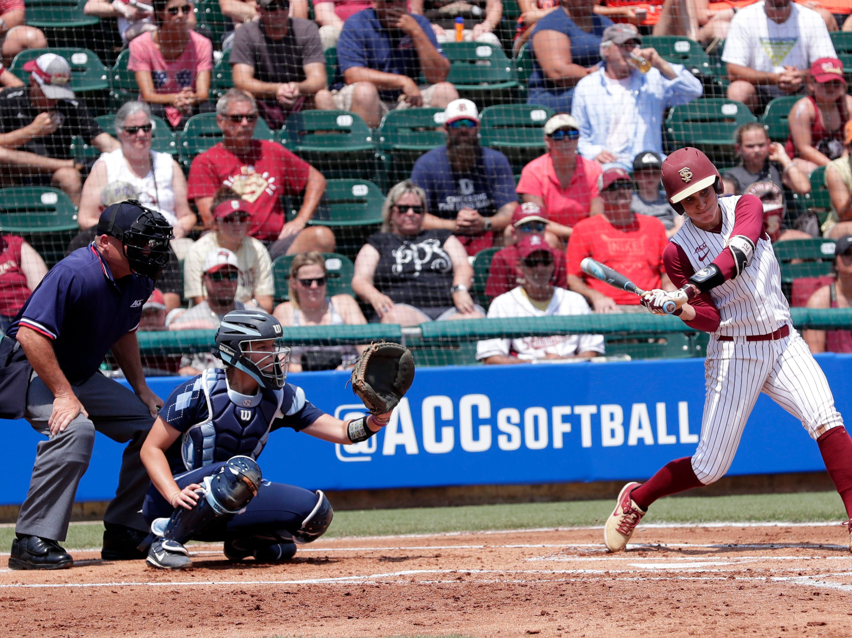 Florida State Seminoles infielder Carsyn Gordon (12) swings at the pitch. The Florida State Seminoles host the UNC Tar Heels for the ACC Softball Tournament finals Saturday, May 11, 2019.