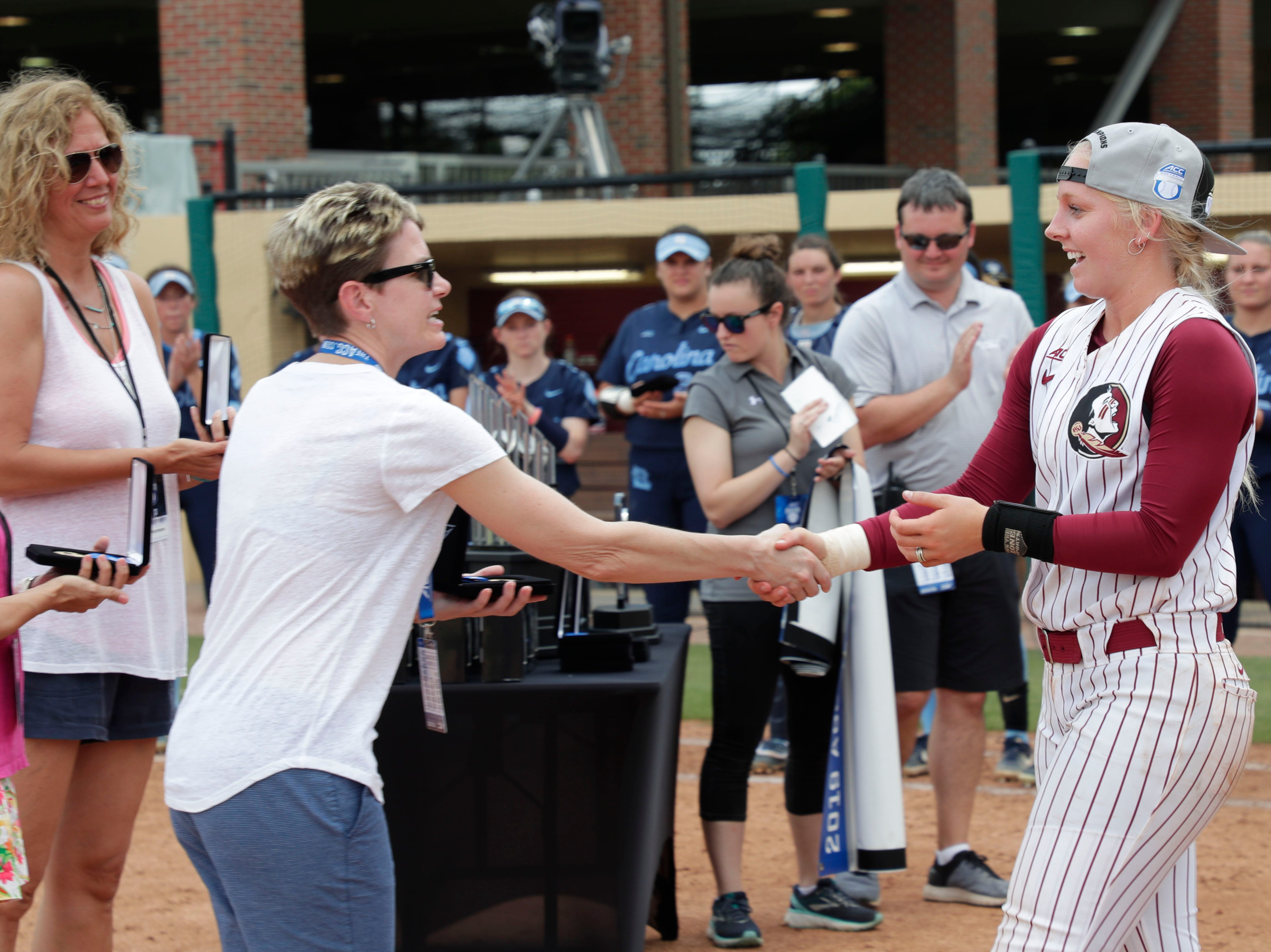 Florida State Seminoles utility player Sydney Sherrill (24) receives an award. The Florida State Seminoles celebrate their victory over the UNC Tar Heels for the ACC Softball Championship title Saturday, May 11, 2019.