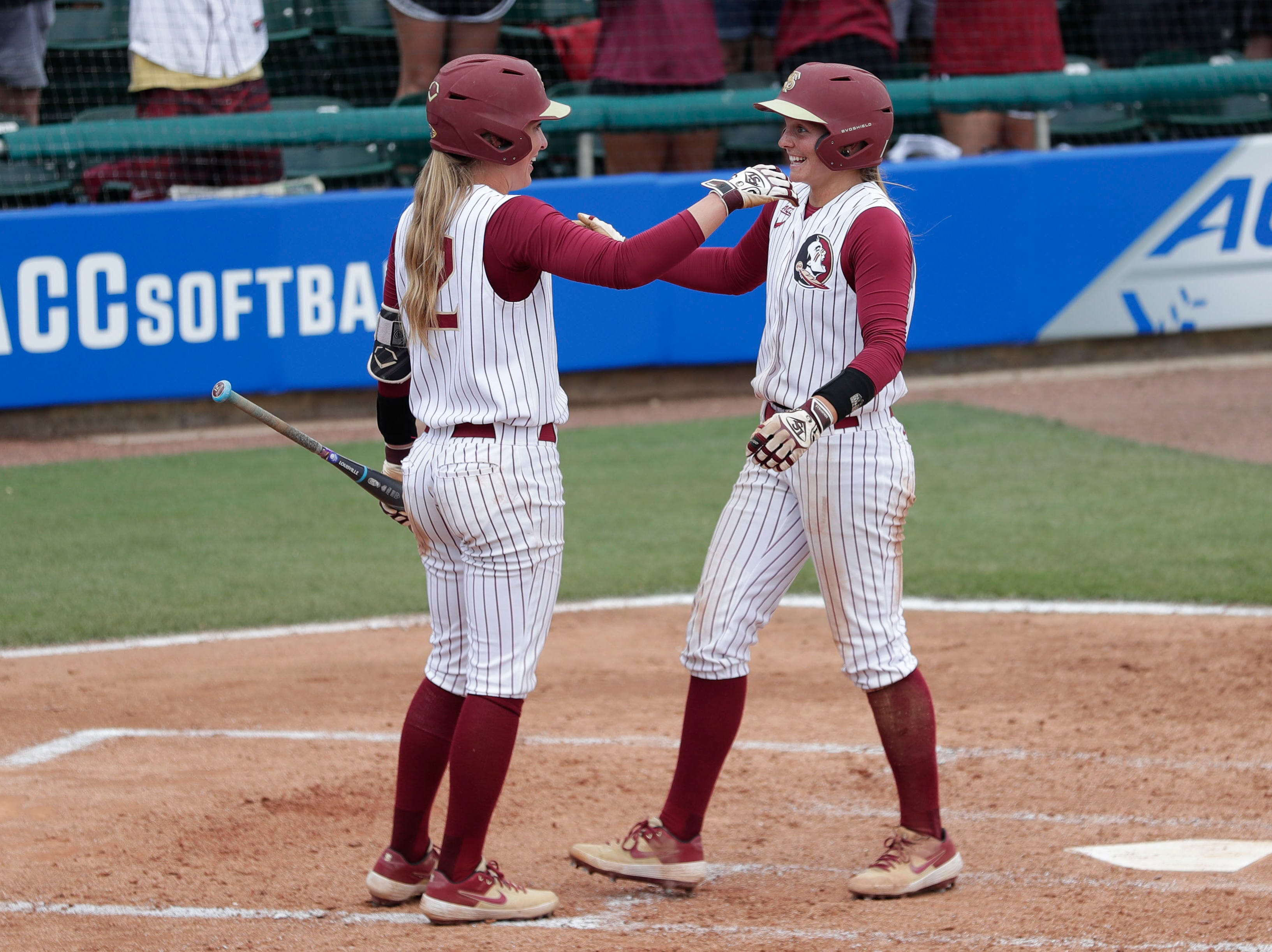 Florida State Seminoles infielder Cali Harrod (10) hugs Florida State Seminoles infielder Carsyn Gordon (12) after hitting a home run. The Florida State Seminoles host the UNC Tar Heels for the ACC Softball Tournament finals Saturday, May 11, 2019.