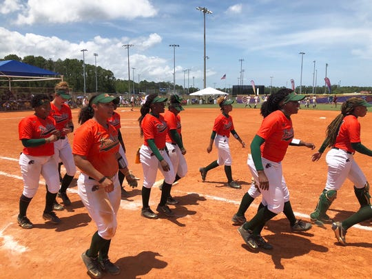 FAMU softball players celebrate a 1-0 victory over Bethune-Cookman in the MEAC Softball Tournament. The teams will next play in a winner-take-all match.