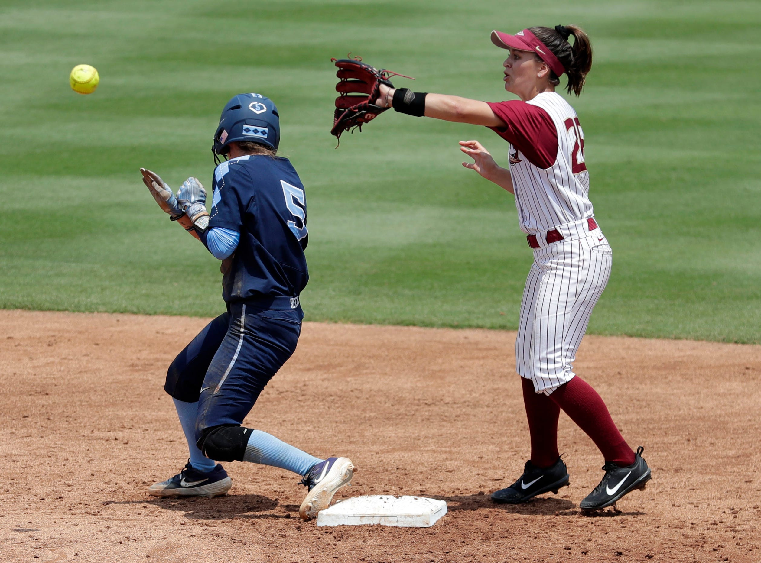 Florida State Seminoles infielder Leslie Farris (26) barely misses getting the put at second base. The Florida State Seminoles host the UNC Tar Heels for the ACC Softball Tournament finals Saturday, May 11, 2019.