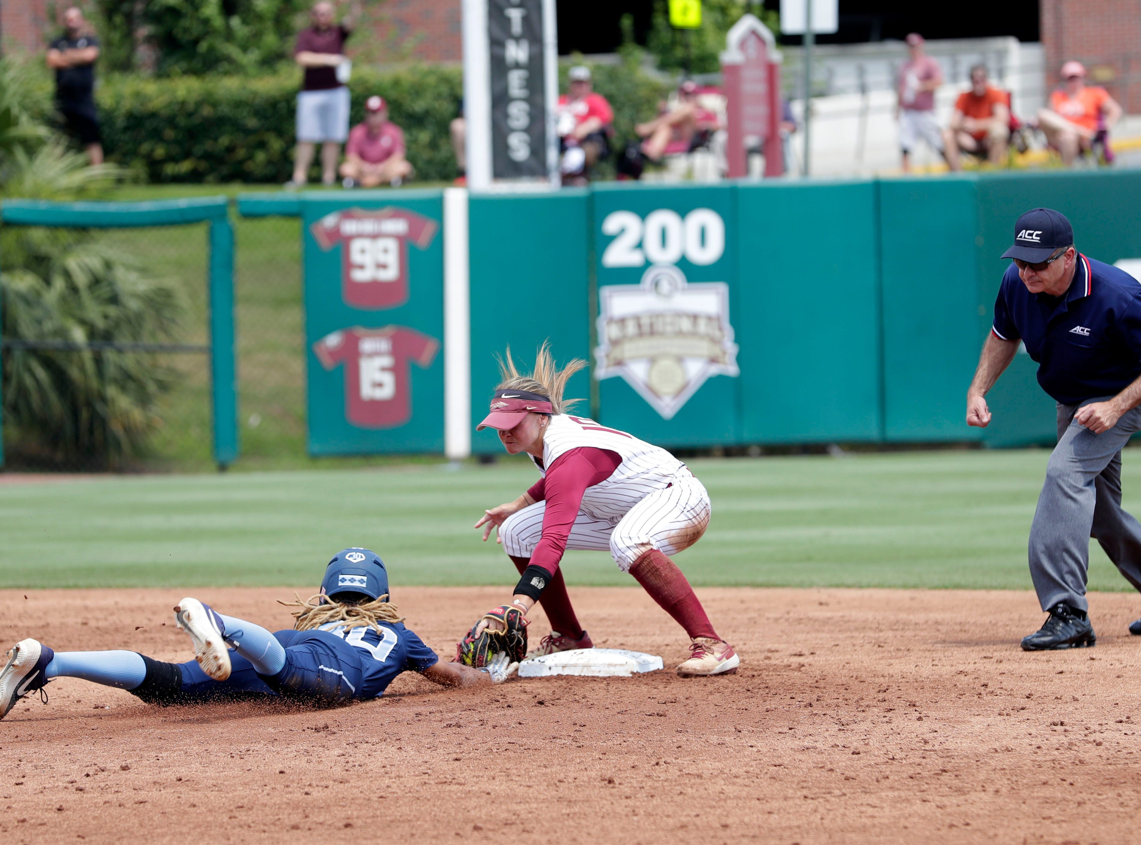 Florida State Seminoles infielder Cali Harrod (10) tags the runner to get the out at second base. The Florida State Seminoles host the UNC Tar Heels for the ACC Softball Tournament finals Saturday, May 11, 2019.