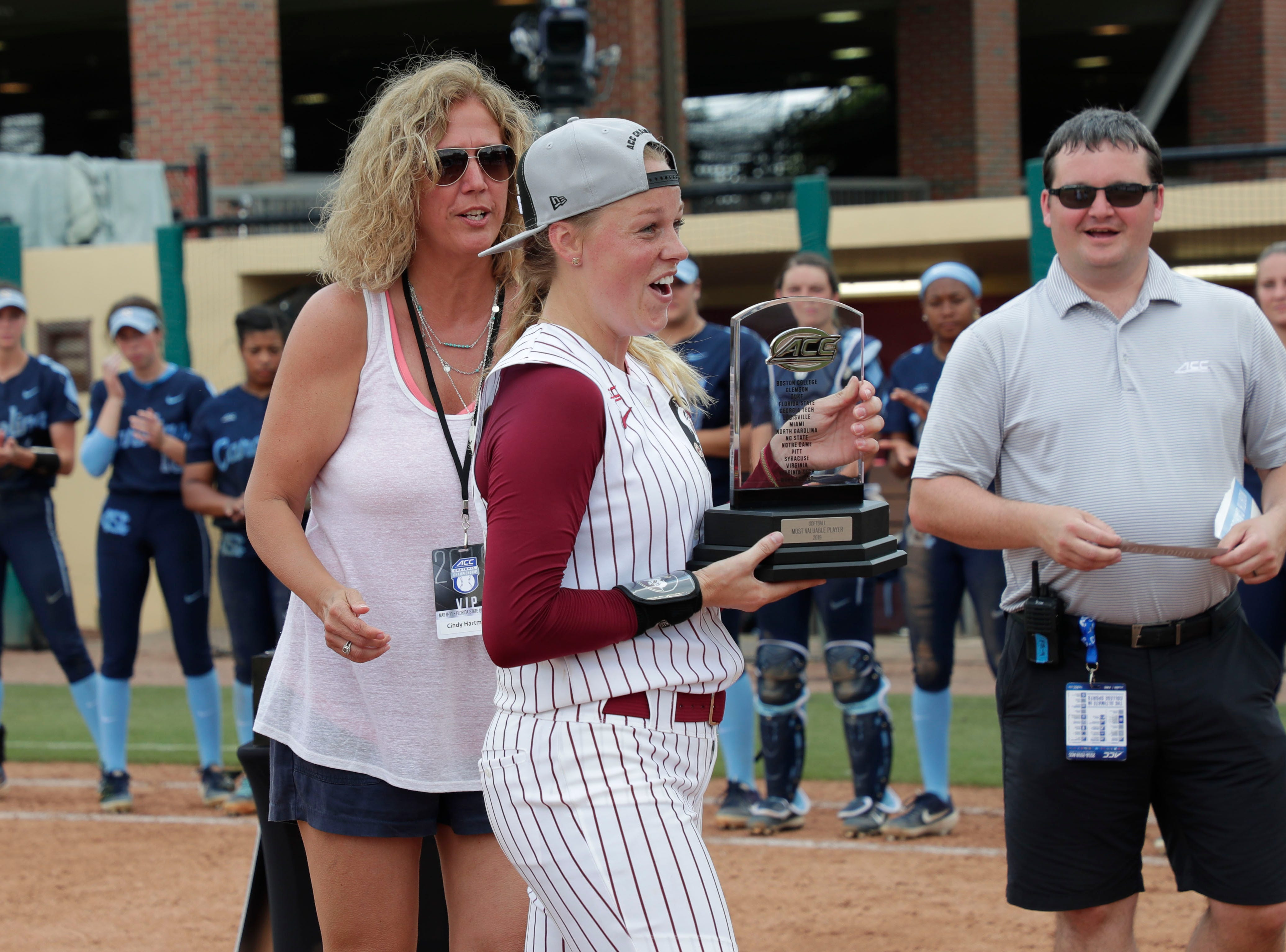 Florida State Seminoles starting pitcher/relief pitcher Meghan King (48) receives the award for MVP. The Florida State Seminoles celebrate their victory over the UNC Tar Heels for the ACC Softball Championship title Saturday, May 11, 2019.