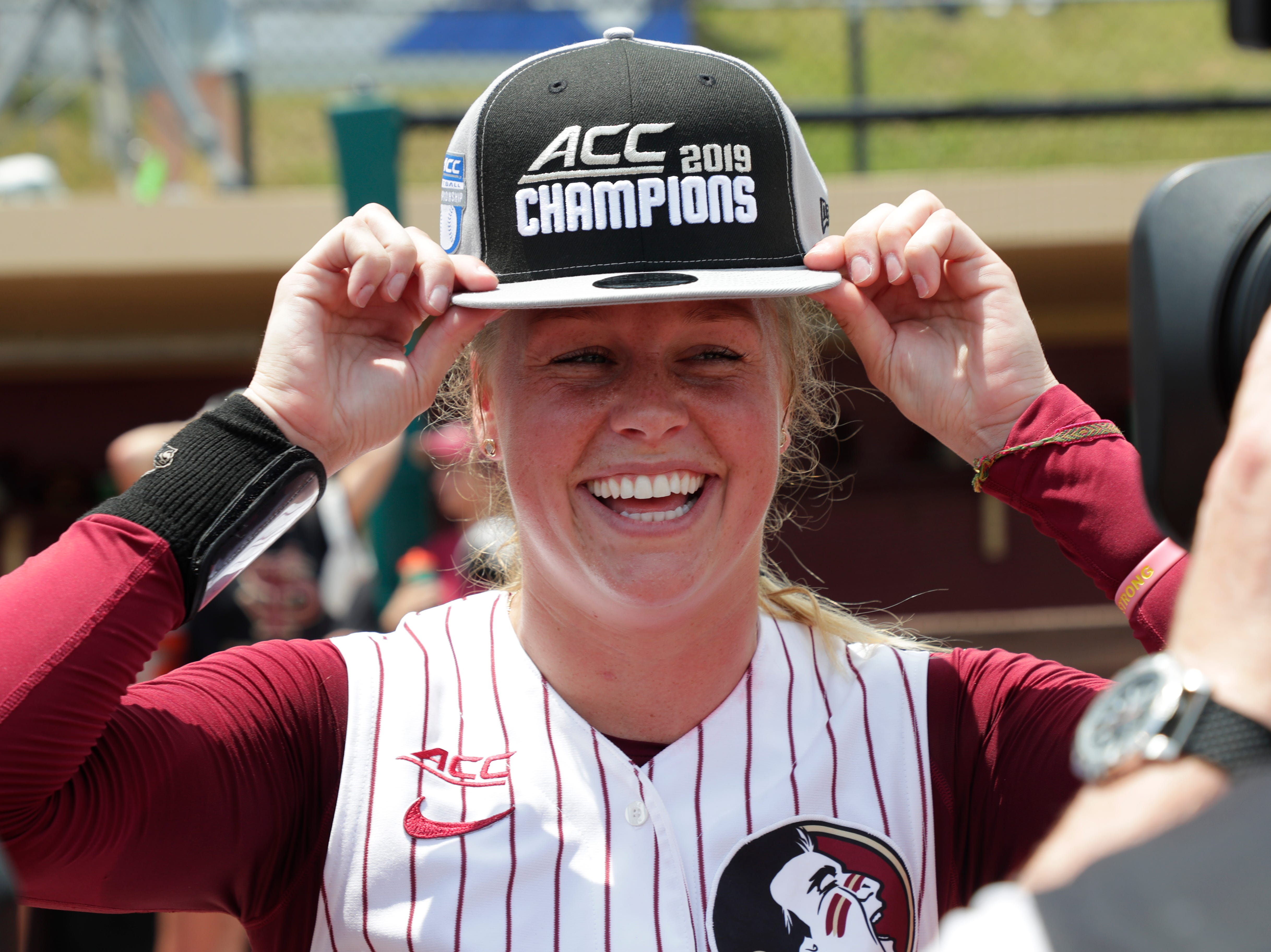 Florida State Seminoles starting pitcher/relief pitcher Meghan King (48) poses with her new hat. The Florida State Seminoles celebrate their victory over the UNC Tar Heels for the ACC Softball Championship title Saturday, May 11, 2019.