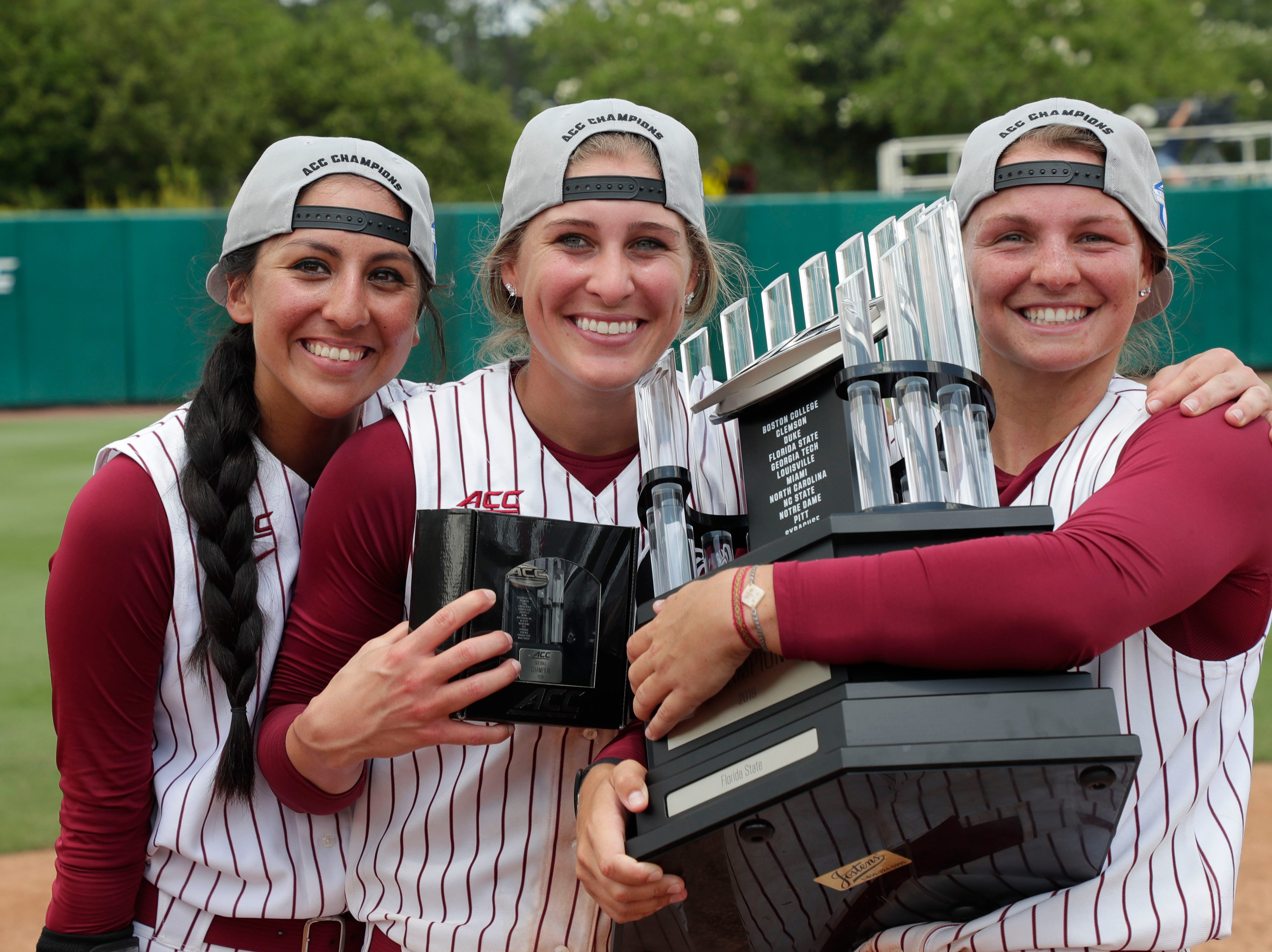 Florida State Seminoles outfielder Zoe Casas (6), Florida State Seminoles infielder Carsyn Gordon (12), and Florida State Seminoles infielder Cali Harrod (10) pose for a photo with their trophies. The Florida State Seminoles celebrate their victory over the UNC Tar Heels for the ACC Softball Championship title Saturday, May 11, 2019.