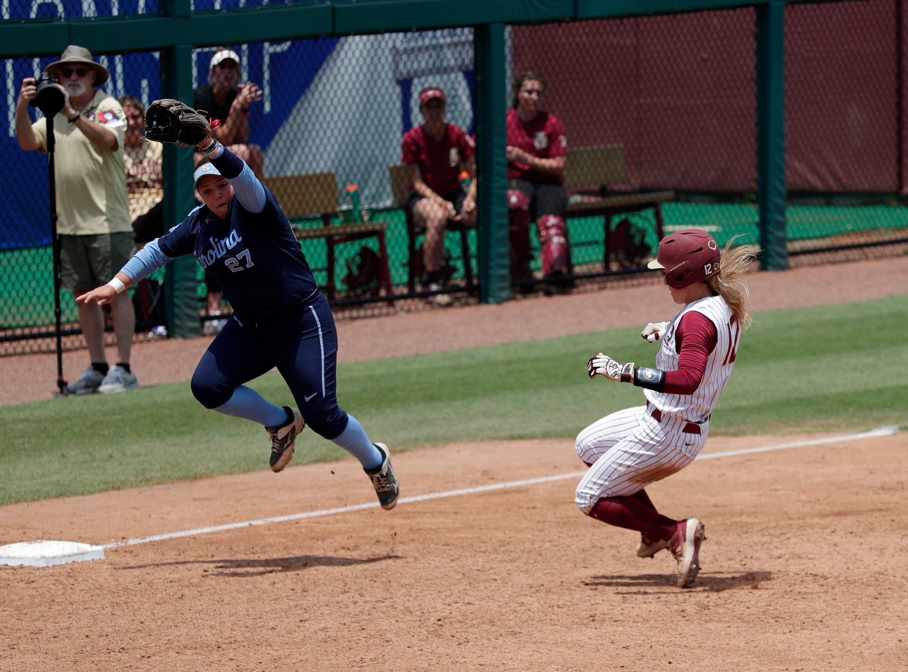 Florida State Seminoles infielder Carsyn Gordon (12) slides into third base. The Florida State Seminoles host the UNC Tar Heels for the ACC Softball Tournament finals Saturday, May 11, 2019.