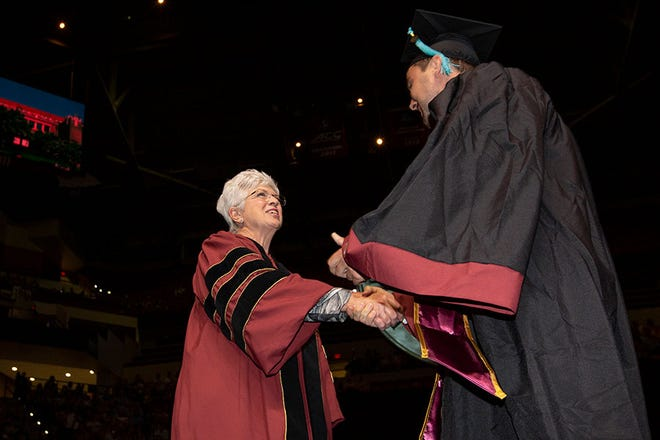 Jan Moran congratulates Cory Witt, the first graduate of the Jim Moran School of Entrepreneurship, during the May 3, 2019 commencement at Florida State University.
