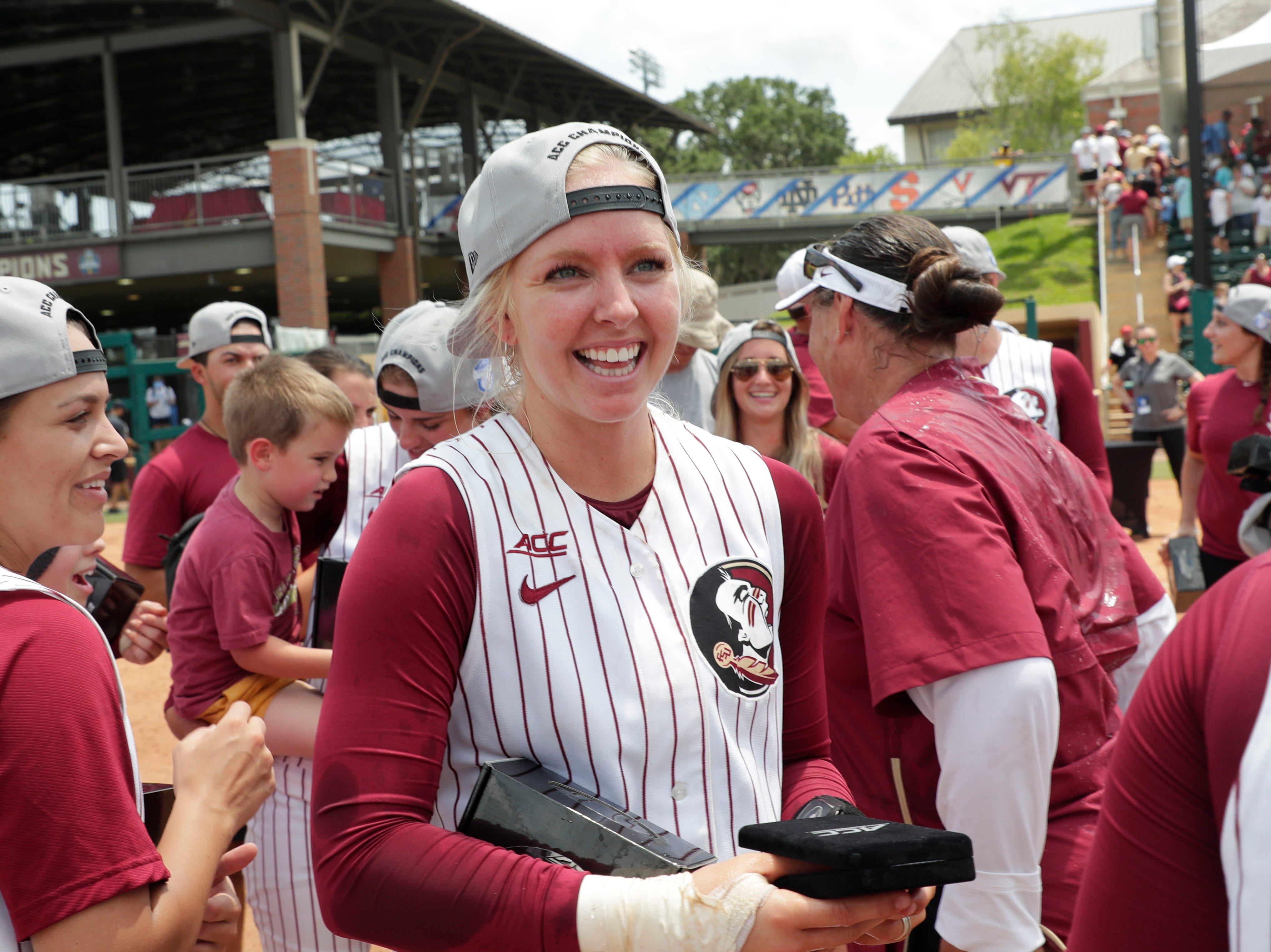Florida State Seminoles utility player Sydney Sherrill (24) smiles as she takes it all in. The Florida State Seminoles celebrate their victory over the UNC Tar Heels for the ACC Softball Championship title Saturday, May 11, 2019.