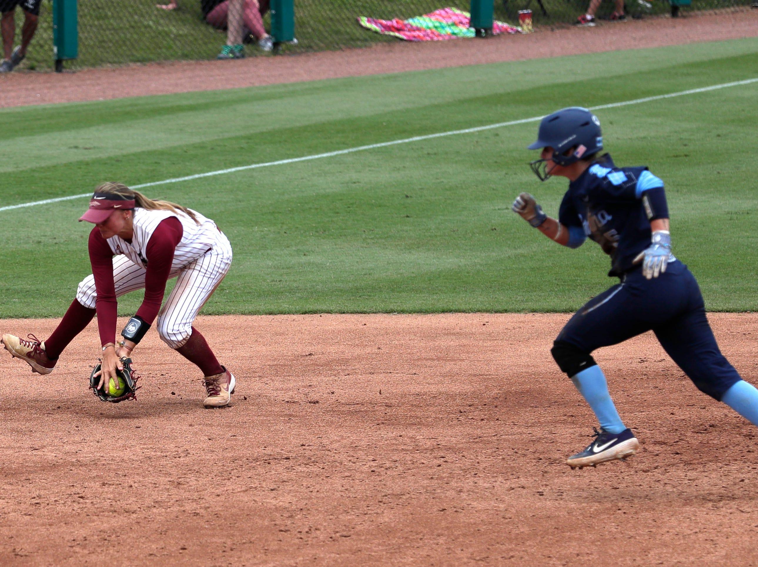 Florida State Seminoles infielder Cali Harrod (10) scoops up a ground ball. The Florida State Seminoles host the UNC Tar Heels for the ACC Softball Tournament finals Saturday, May 11, 2019.