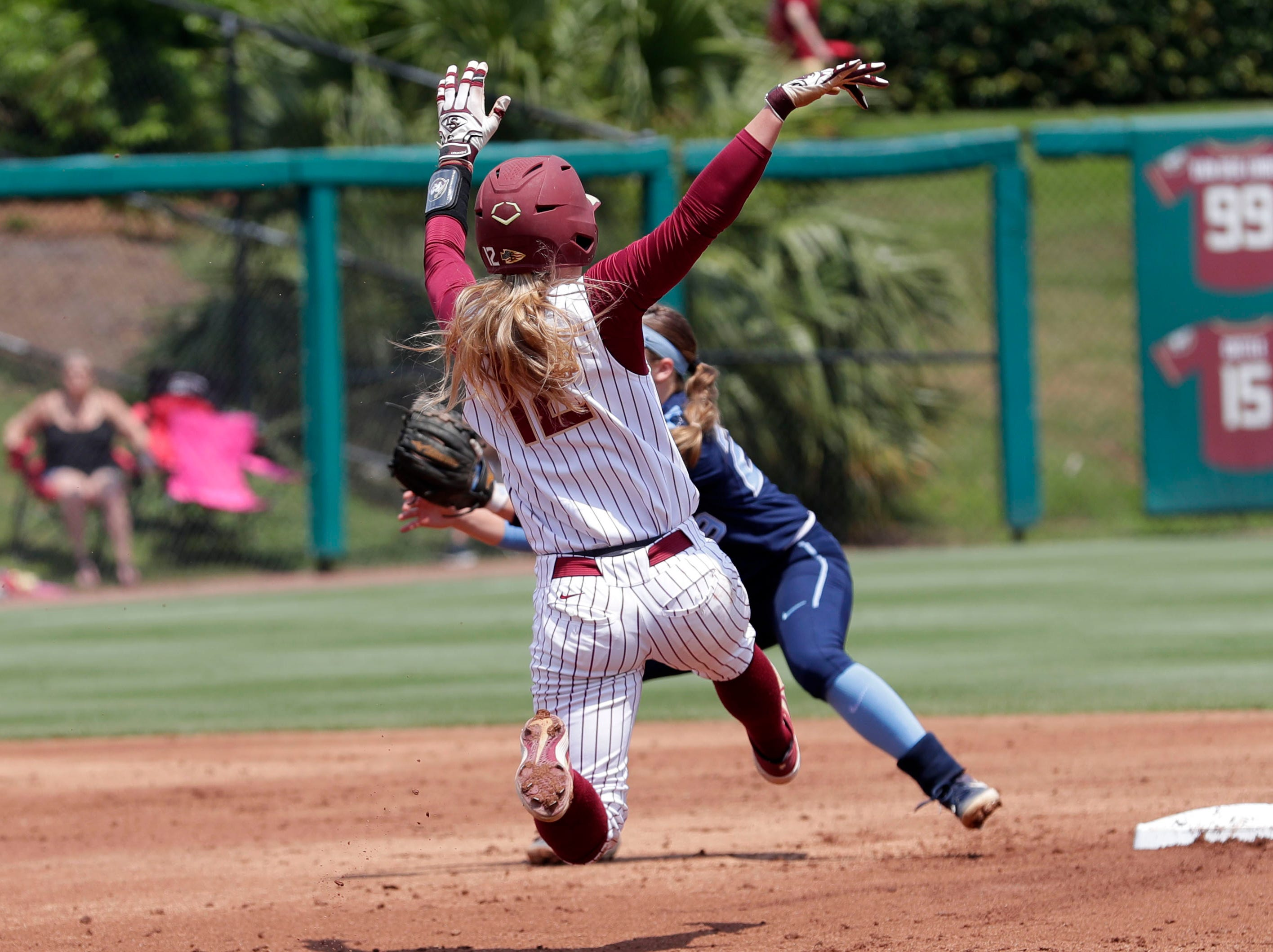 Florida State Seminoles infielder Carsyn Gordon (12) slides into second. The Florida State Seminoles host the UNC Tar Heels for the ACC Softball Tournament finals Saturday, May 11, 2019.