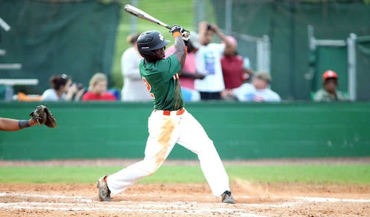 FAMU outfielder Willis McDaniel gets a base hit against North Carolina A&T in Greensboro. The Rattlers dropped two of three in the series to finish the regular season in second place in the MEAC Southern Division.
