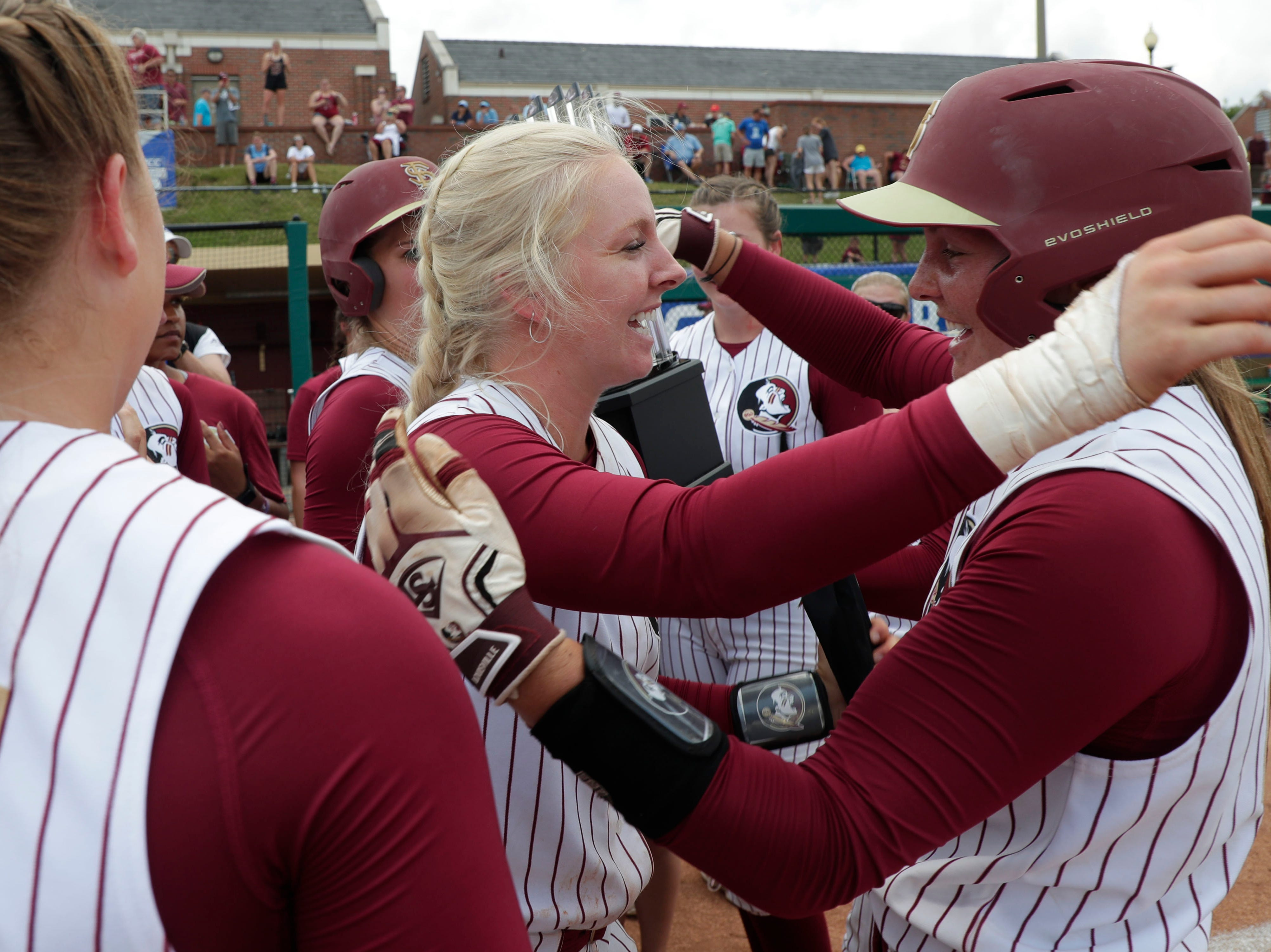 Florida State Seminoles utility player Sydney Sherrill (24) and Florida State Seminoles infielder Cali Harrod (10) hug each other during the excitement. The Florida State Seminoles celebrate their victory over the UNC Tar Heels for the ACC Softball Championship title Saturday, May 11, 2019.