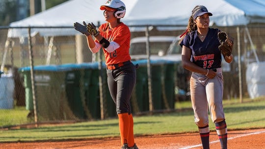 FAMU first baseman Taylor Rosier celebrates after hitting a two-run triple in the first inning versus Howard in the MEAC Softball Tournament on Friday, May 10, 2019. The Rattlers will face Bethune-Cookman in the championship game.