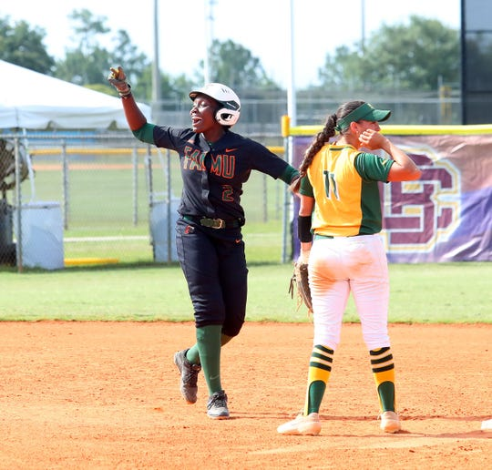 FAMU senior outfielder Tyra Bowers cheers on the team against Norfolk State in the MEAC Softball Tournament on Thursday, May 9, 2019.