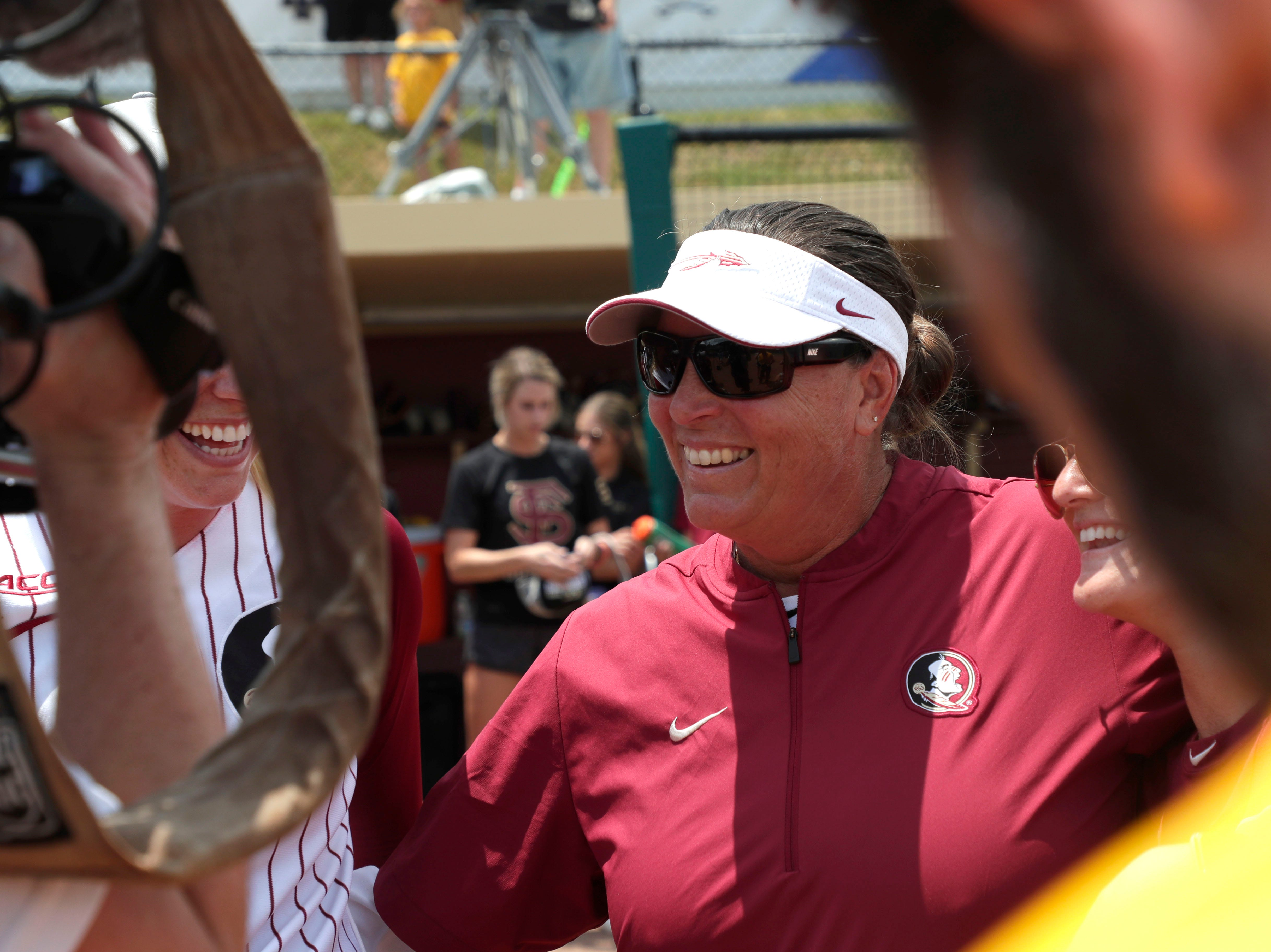 Florida State Seminoles head coach Lonni Alameda celebrates her team's victory. The Florida State Seminoles celebrate their victory over the UNC Tar Heels for the ACC Softball Championship title Saturday, May 11, 2019.