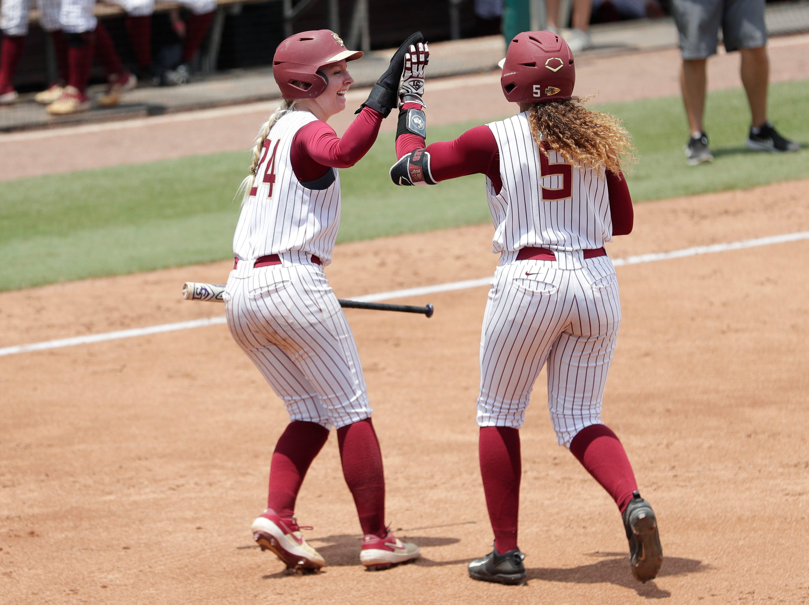 Florida State Seminoles utility player Sydney Sherrill (24) and Florida State Seminoles catcher Elizabeth Mason (5) high five. The Florida State Seminoles host the UNC Tar Heels for the ACC Softball Tournament finals Saturday, May 11, 2019.