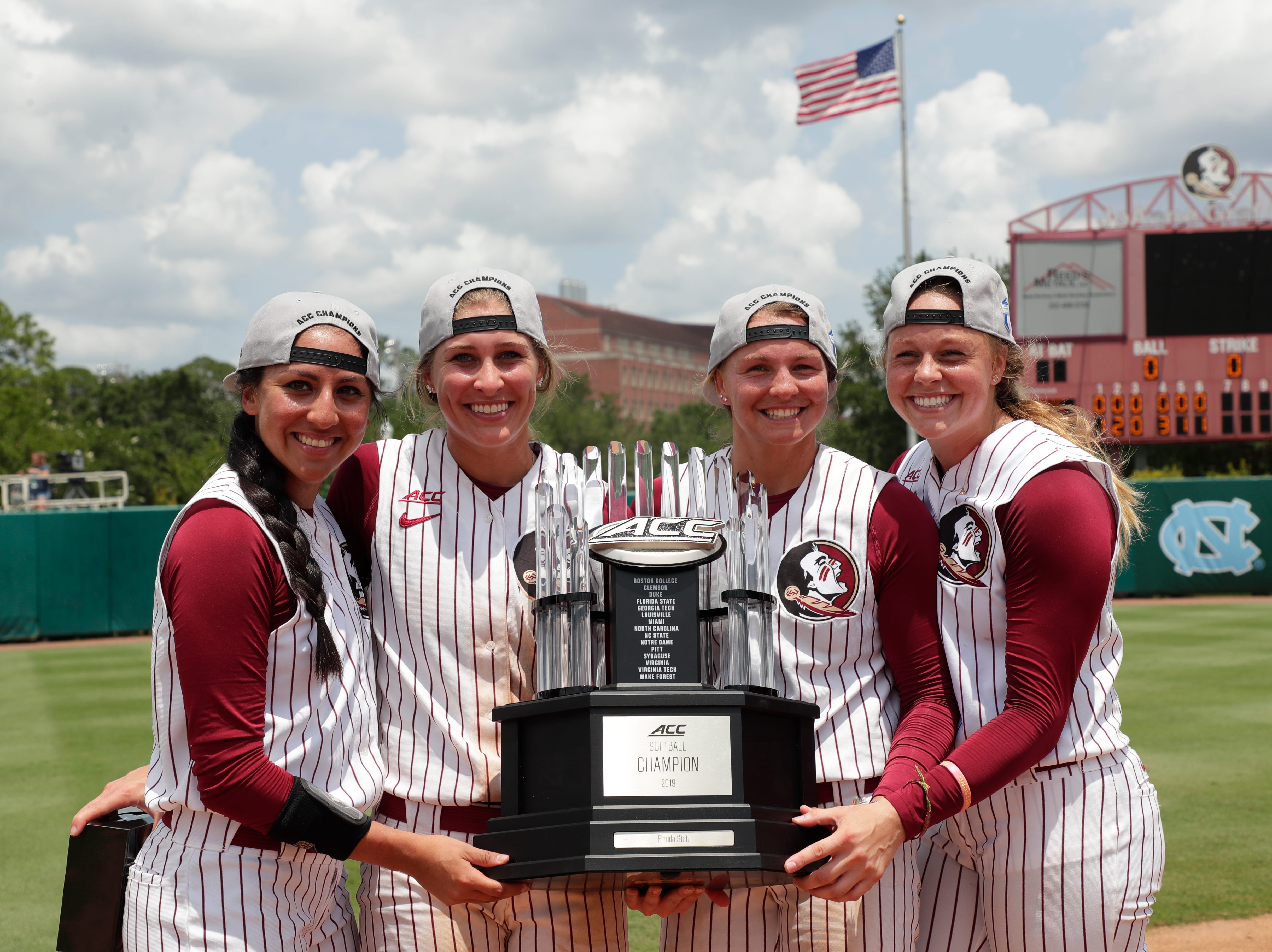 Florida State Seminoles outfielder Zoe Casas (6), Florida State Seminoles infielder Carsyn Gordon (12), Florida State Seminoles infielder Cali Harrod (10), and Florida State Seminoles starting pitcher/relief pitcher Meghan King (48) pose for a photo with the championship trophy. The Florida State Seminoles celebrate their victory over the UNC Tar Heels for the ACC Softball Championship title Saturday, May 11, 2019.