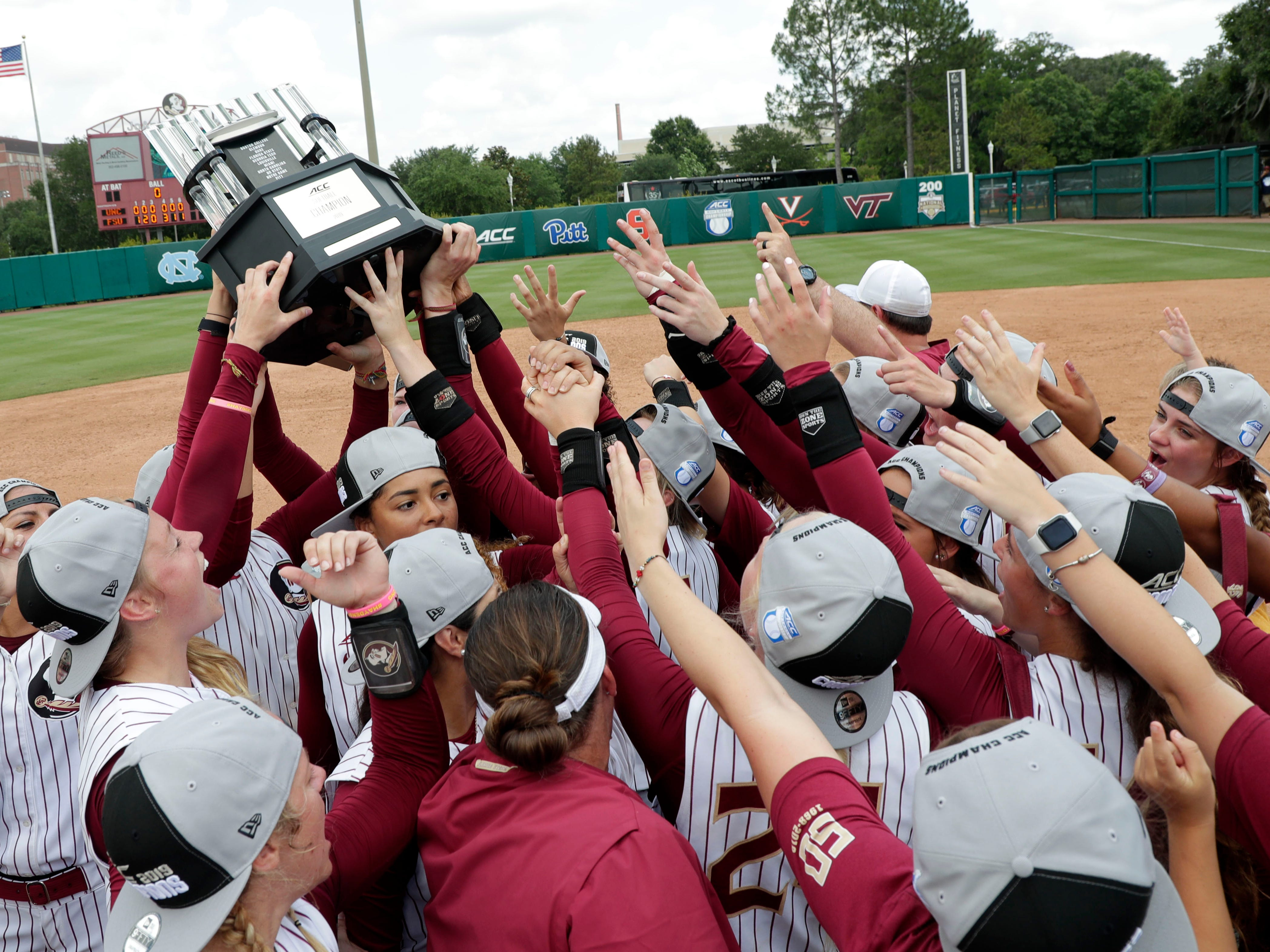 The Florida State Seminoles celebrate their victory over the UNC Tar Heels for the ACC Softball Championship title Saturday, May 11, 2019.