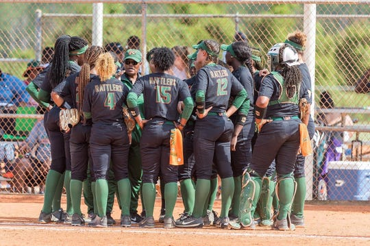 FAMU softball players gather for a pep talk from head coach Veronica Wiggins during the MEAC tournament.