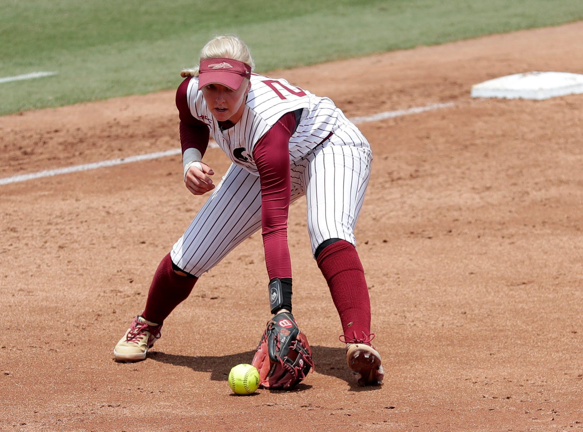 Florida State Seminoles utility player Sydney Sherrill (24) scoops up a ground ball. The Florida State Seminoles host the UNC Tar Heels for the ACC Softball Tournament finals Saturday, May 11, 2019.