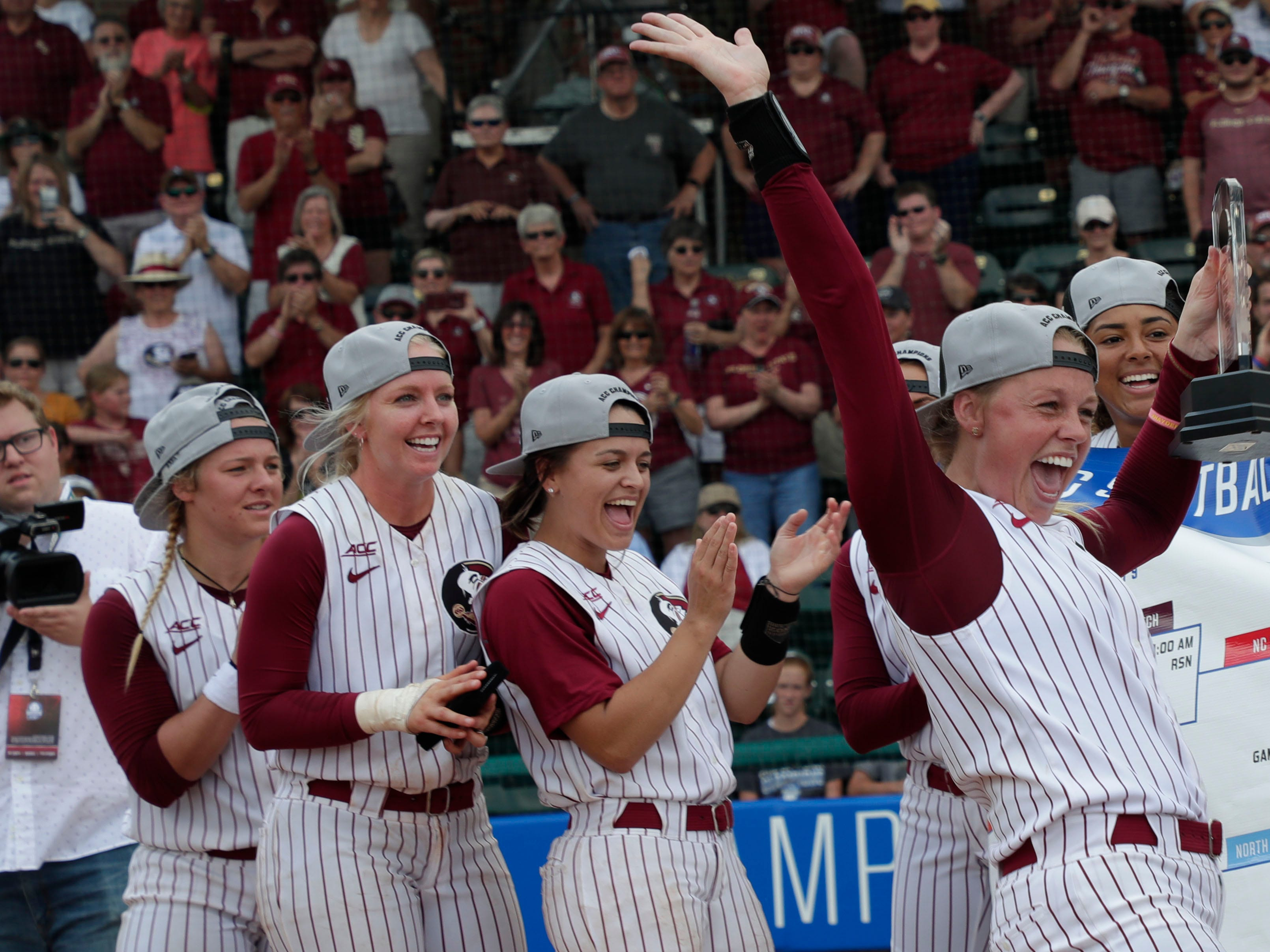 Florida State Seminoles starting pitcher/relief pitcher Meghan King (48) and her teammates cheer. The Florida State Seminoles celebrate their victory over the UNC Tar Heels for the ACC Softball Championship title Saturday, May 11, 2019.