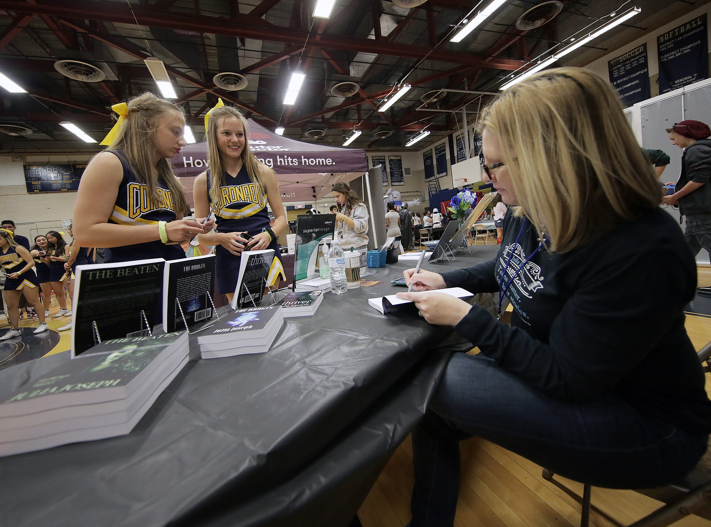 El Paso author Julia Joseph signs copies of her books during Coronado Thundercon Saturday at Coronado High School.
