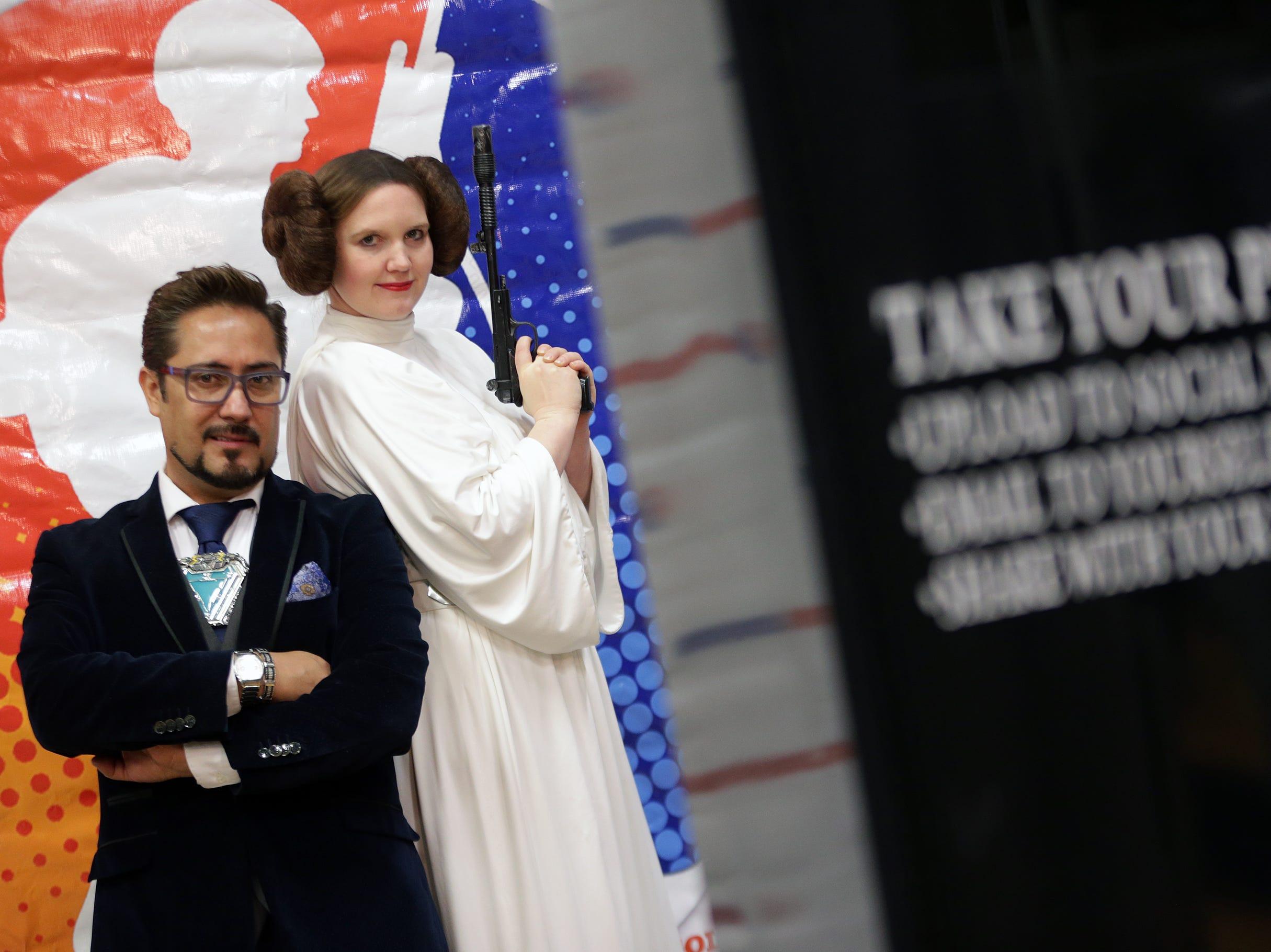 Iron Man takes a photo-booth photo with Princess Leia during the Coronado Thundercon Saturday at Coronado High School.