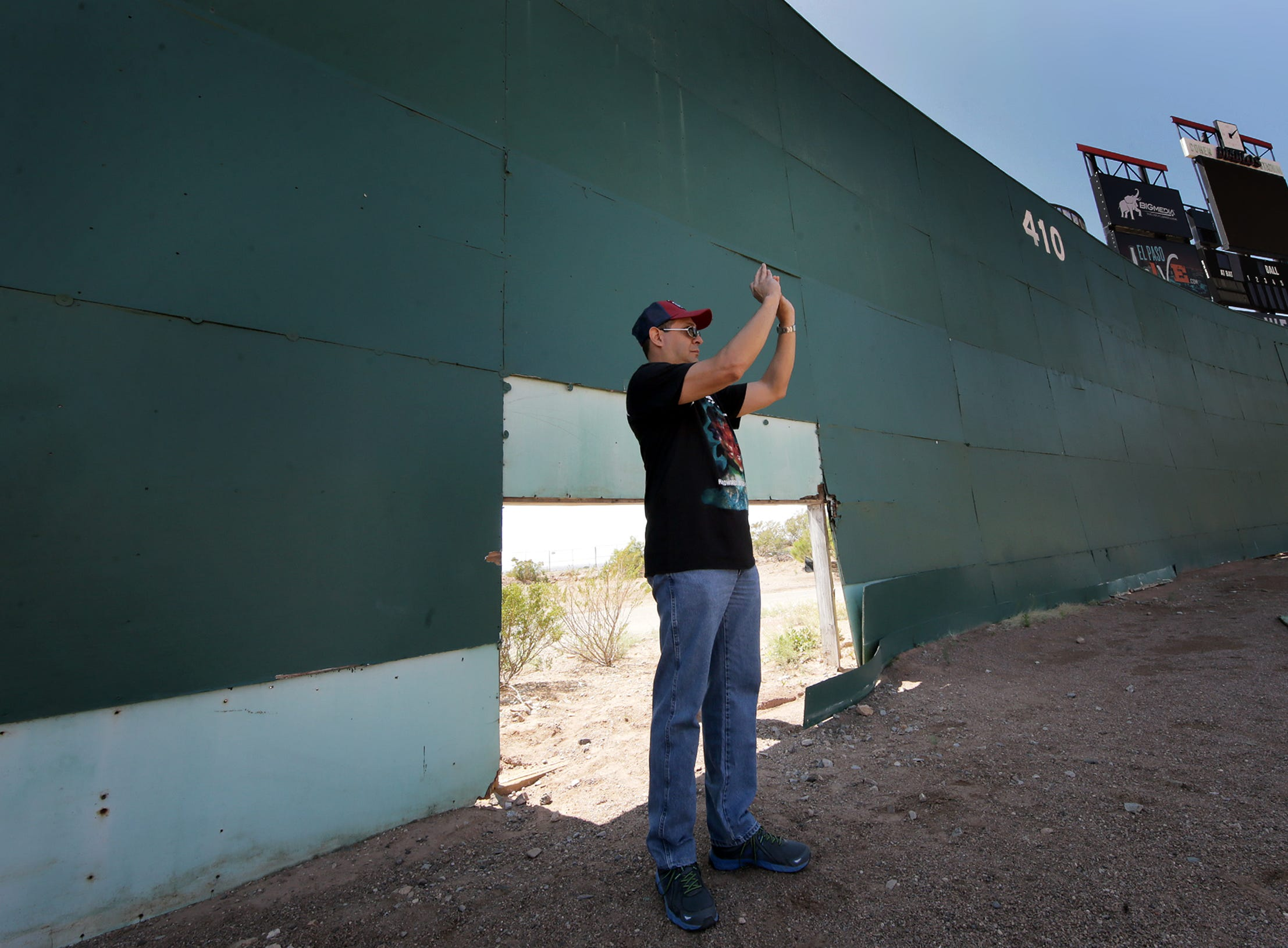 Eugene Lucero takes a few final photos of Cohen Stadium before it's demolished to make way for the Cohen Entertainment District. The site will be converted into a multiuse facility with a large water park, restaurants and an urban plaza. The stadium was closed to the public during Selfie Day at Cohen Stadium on Saturday, May 11, 2019, but several El Pasoans popped through a hole in center field for one last look at the deteriorating stadium.