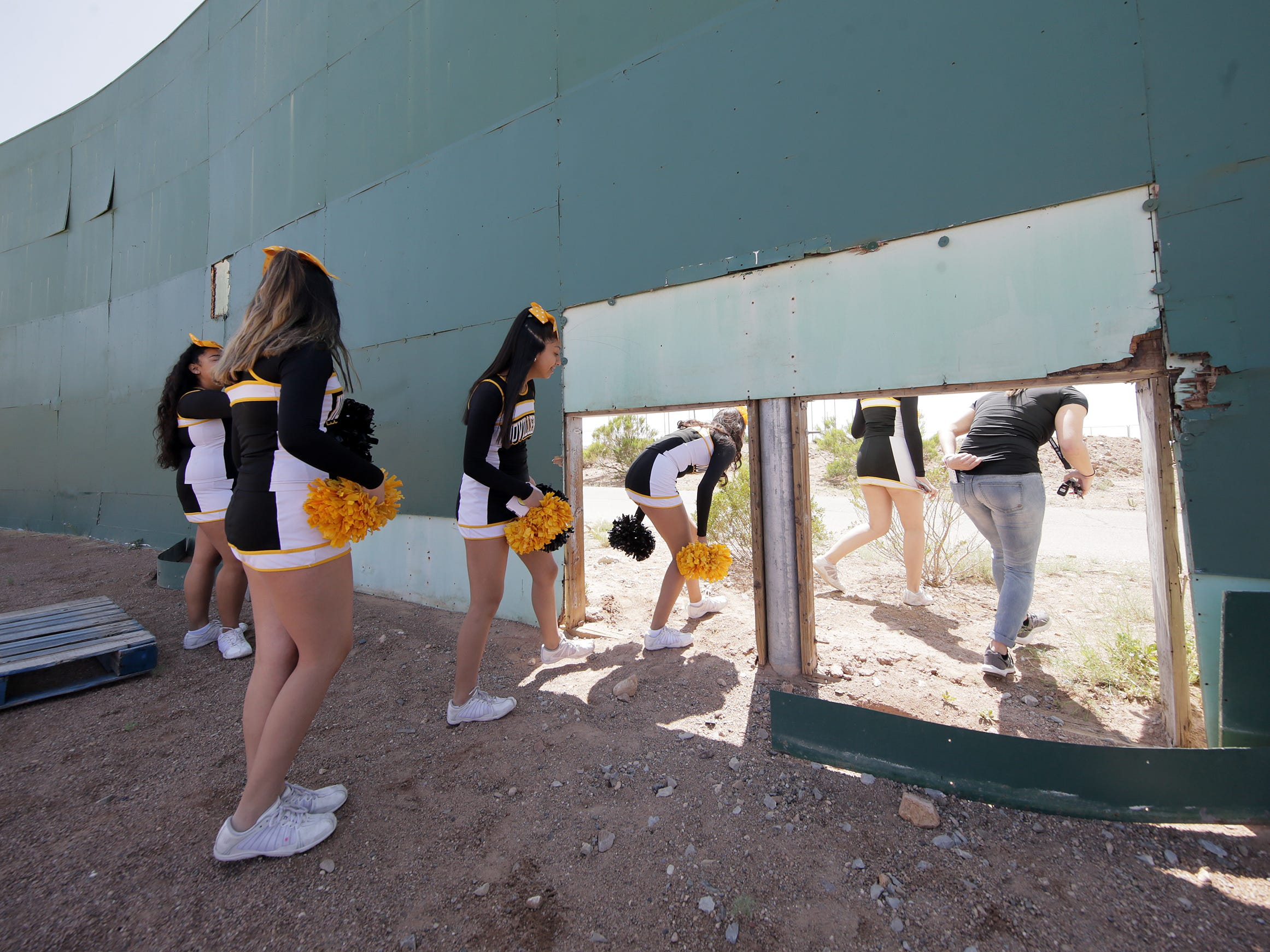 Parkland Middle School Cheerleaders duck through a hole in right-center field at Cohen Stadium during Cohen Selfie Day Saturday. Their coach, Bailey Sarver, once worked for the Diablos. El Pasoans got to say goodbye to Cohen Stadium before it's demolished to make way for the Cohen Entertainment District. The site will be converted into a multi-use facility with a large water park, restaurants and an urban plaza. The stadium was closed to the public during Selfie Day at Cohen Stadium on Saturday, May 11, 2019, but several El Pasoans popped through a hole in right-center field for one last look at the deteriorating stadium.