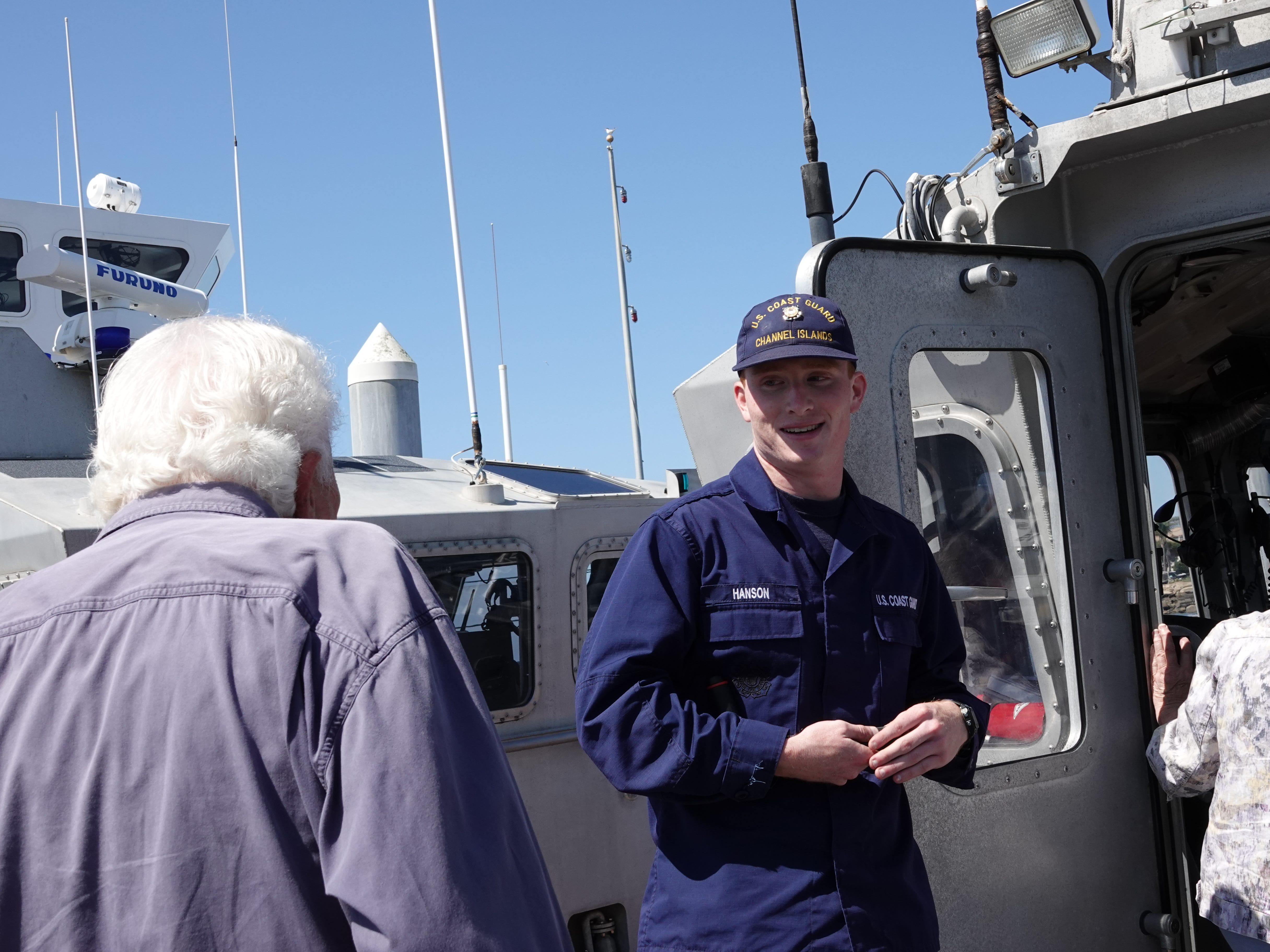 Coast Guard Seaman Ethan Hanson welcomes visitors aboard a 45-foot emergency response boat during Saturday's Safe Boating Expo at Channel Islands Harbor.