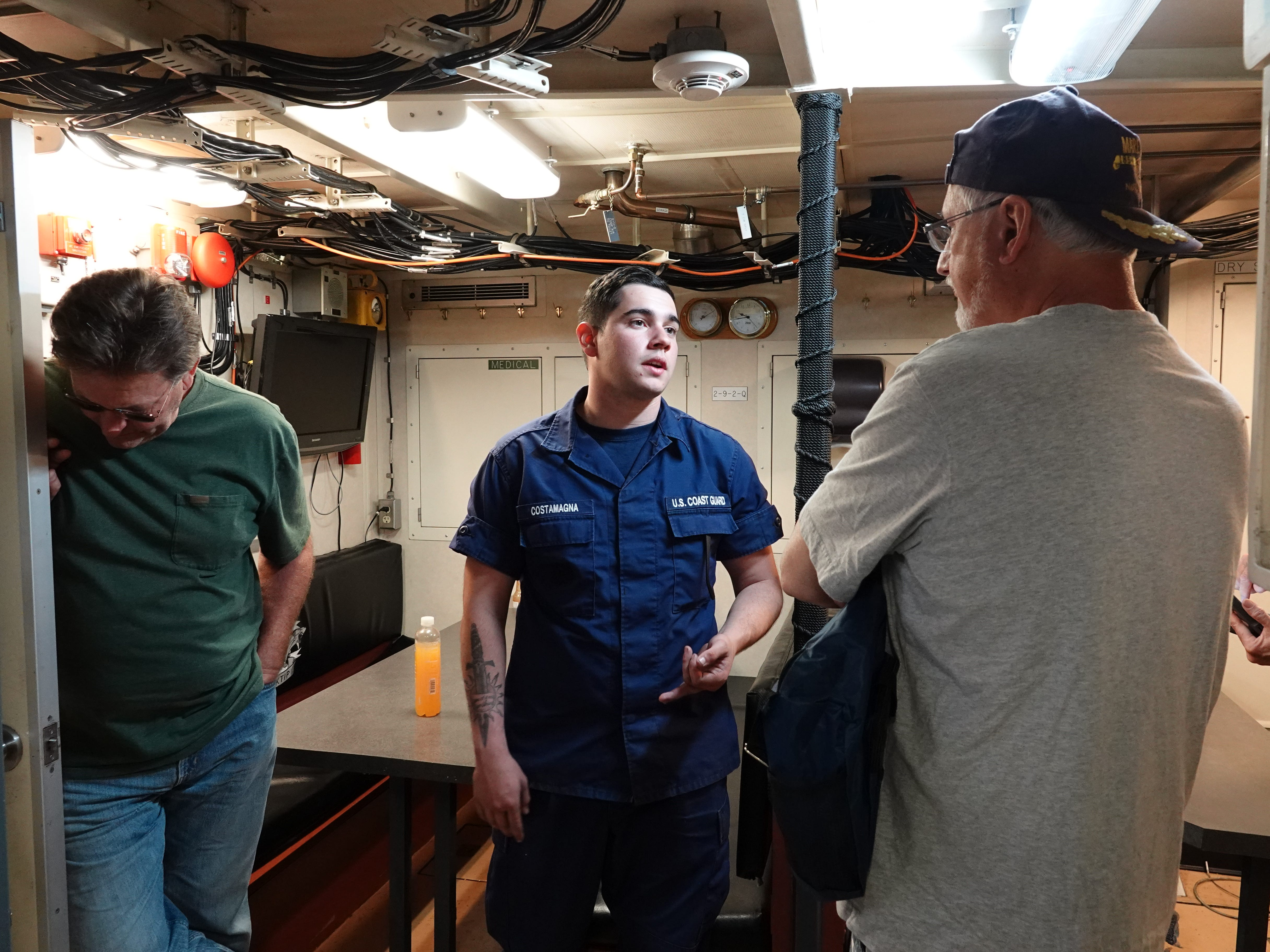 Coast Guard Fireman Chase Costamagna shows visitors the galley of the Blacktip, an 87-foot cutter, during Saturday's Safe Boating Expo at Channel Islands Harbor.