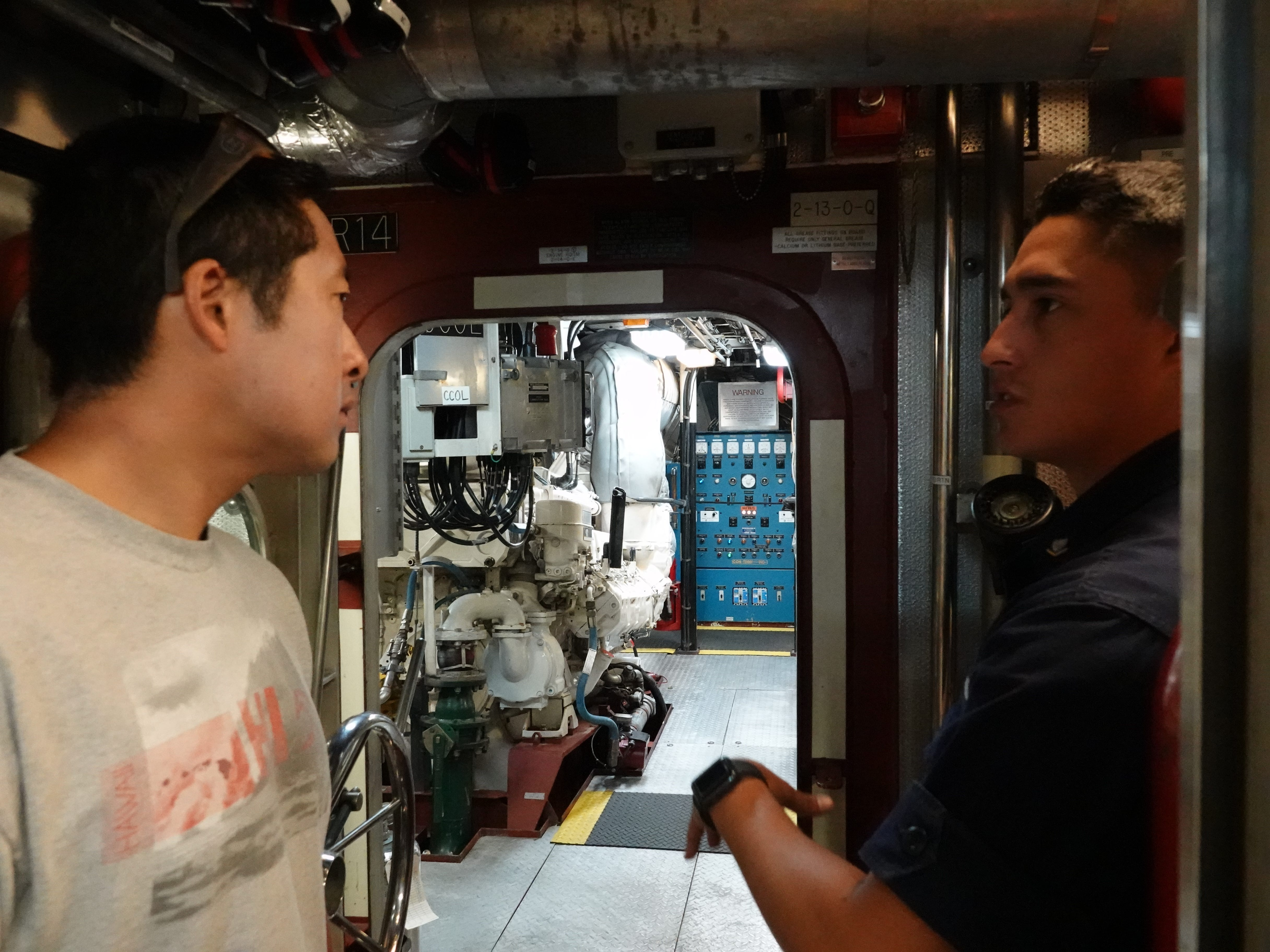 Charles Lee, left, listens as Coast Guard Machinery Technician Anthony Guerrero describes the engine room aboard the cutter Blacktip during Saturday's Safe Boating Expo at Channel Islands Harbor.