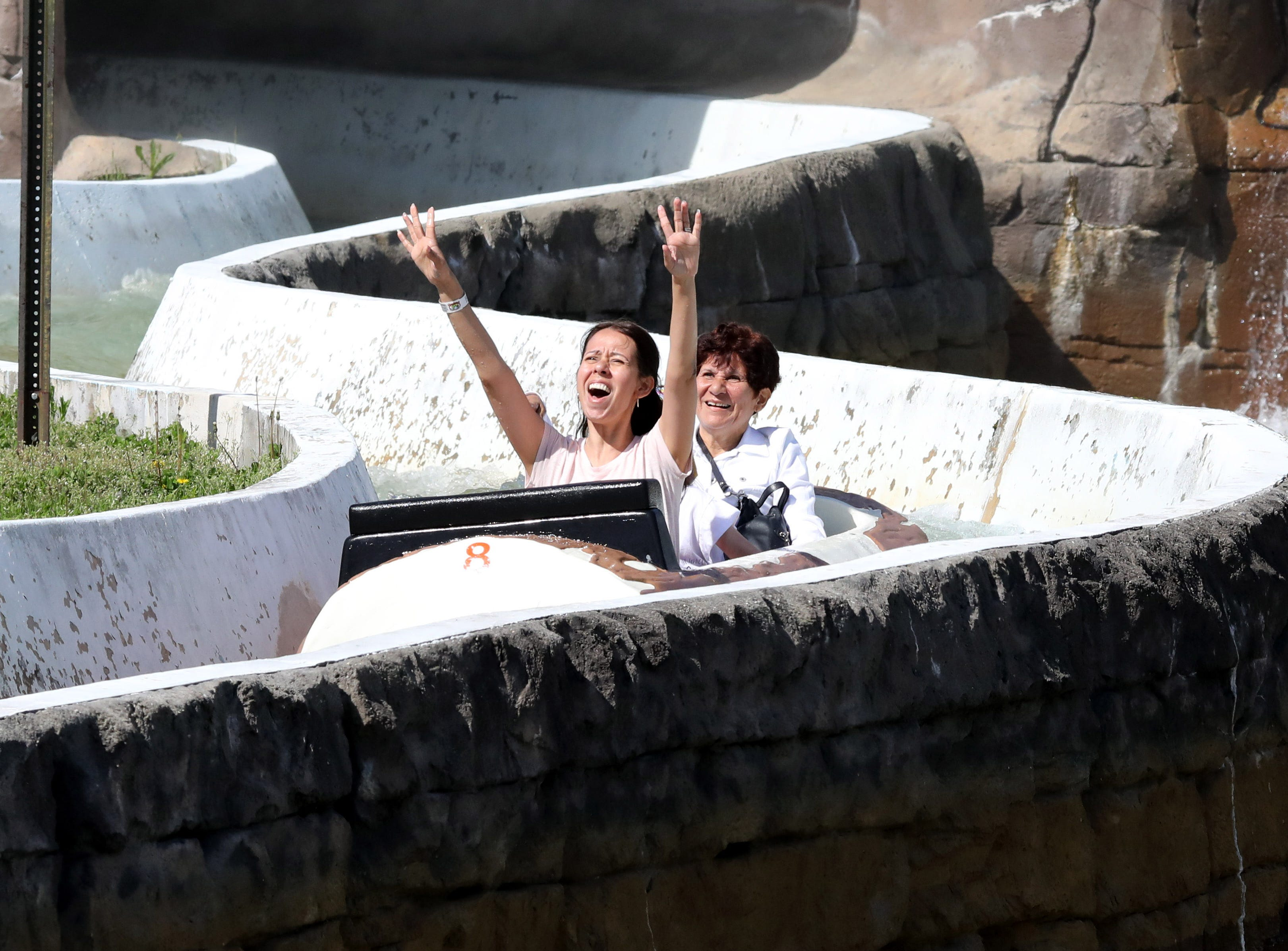 From front; Janette Jennings, Kayleigh Jennings, 7, and Waleska Guzman enjoy the Log Flume during opening day at Playland in Rye, May 11, 2019.