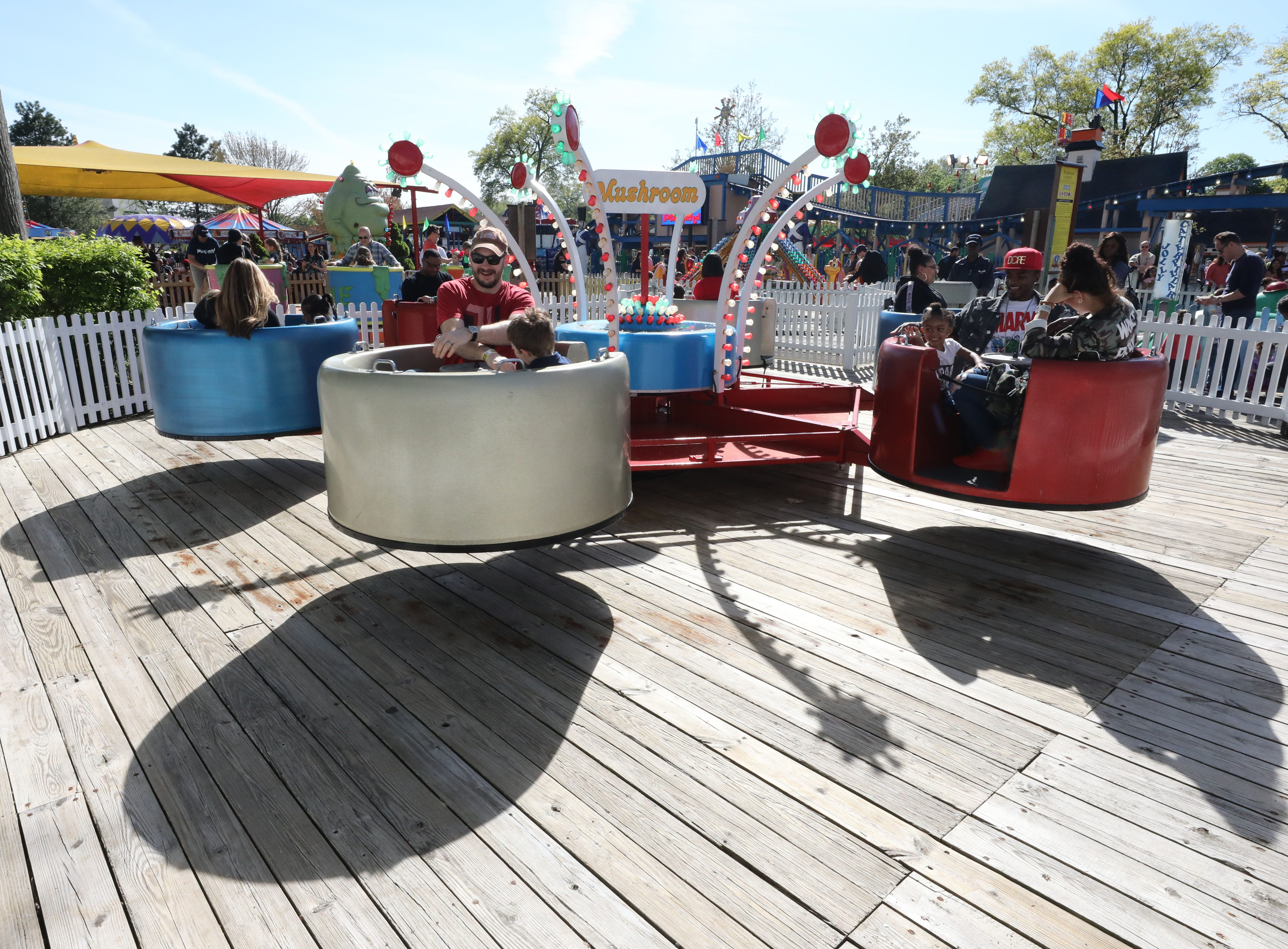 Children and adults enjoy the mushroom ride in kiddieland  during opening day at Playland in Rye, May 11, 2019.
