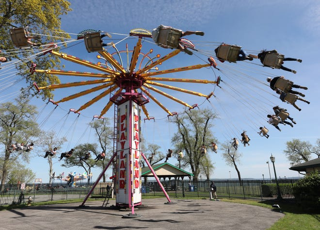 Riders on the Yo-Yo fly high in the air during opening day at Playland in Rye, May 11, 2019.