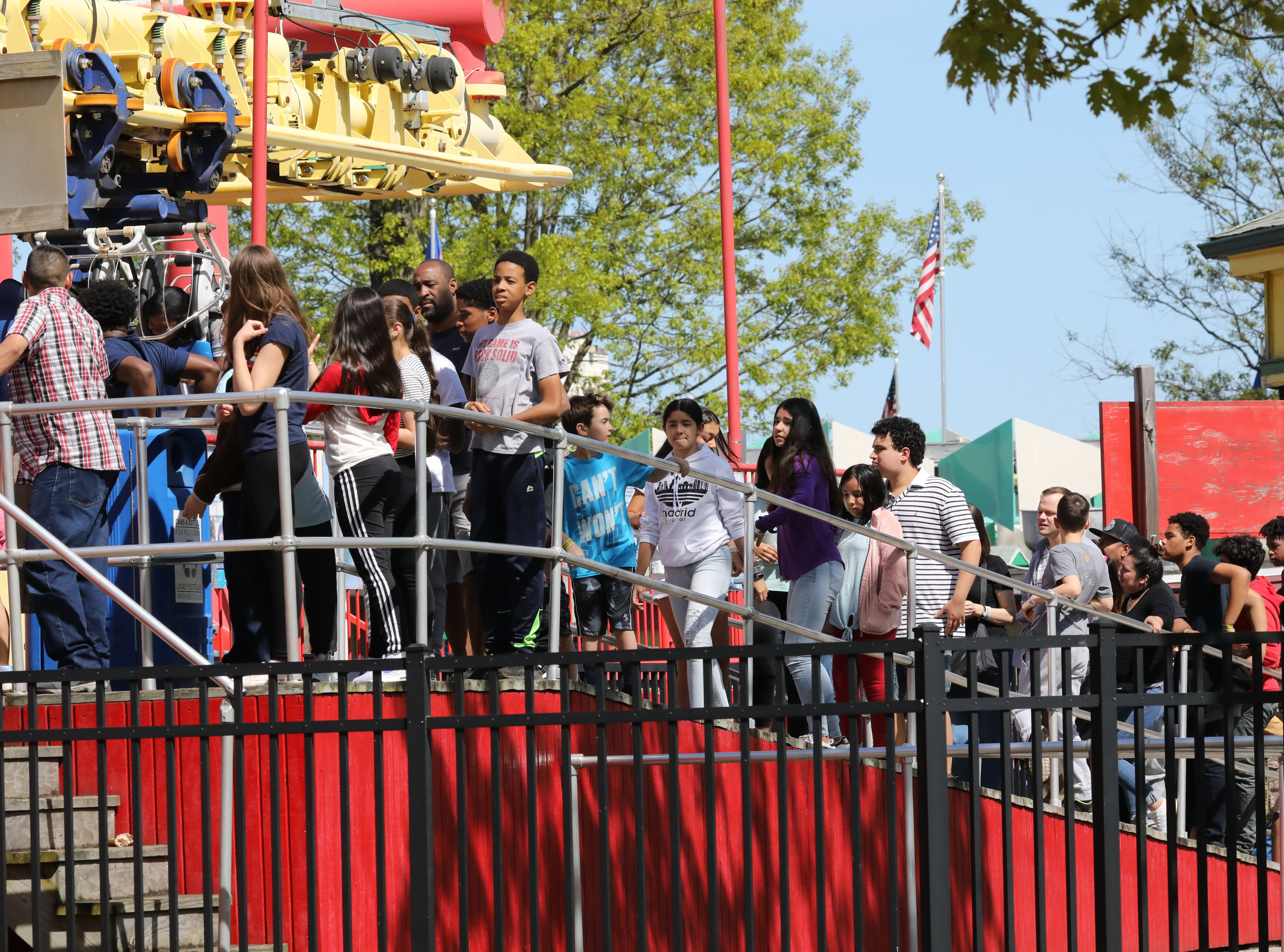 The beautiful weather brought out many people as riders line up to board the Superflight during opening day at Playland in Rye, May 11, 2019.