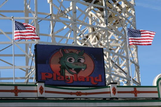 A sign welcomes guests in front of the Dragon Coaster during opening day at Playland in Rye, May 11, 2019.