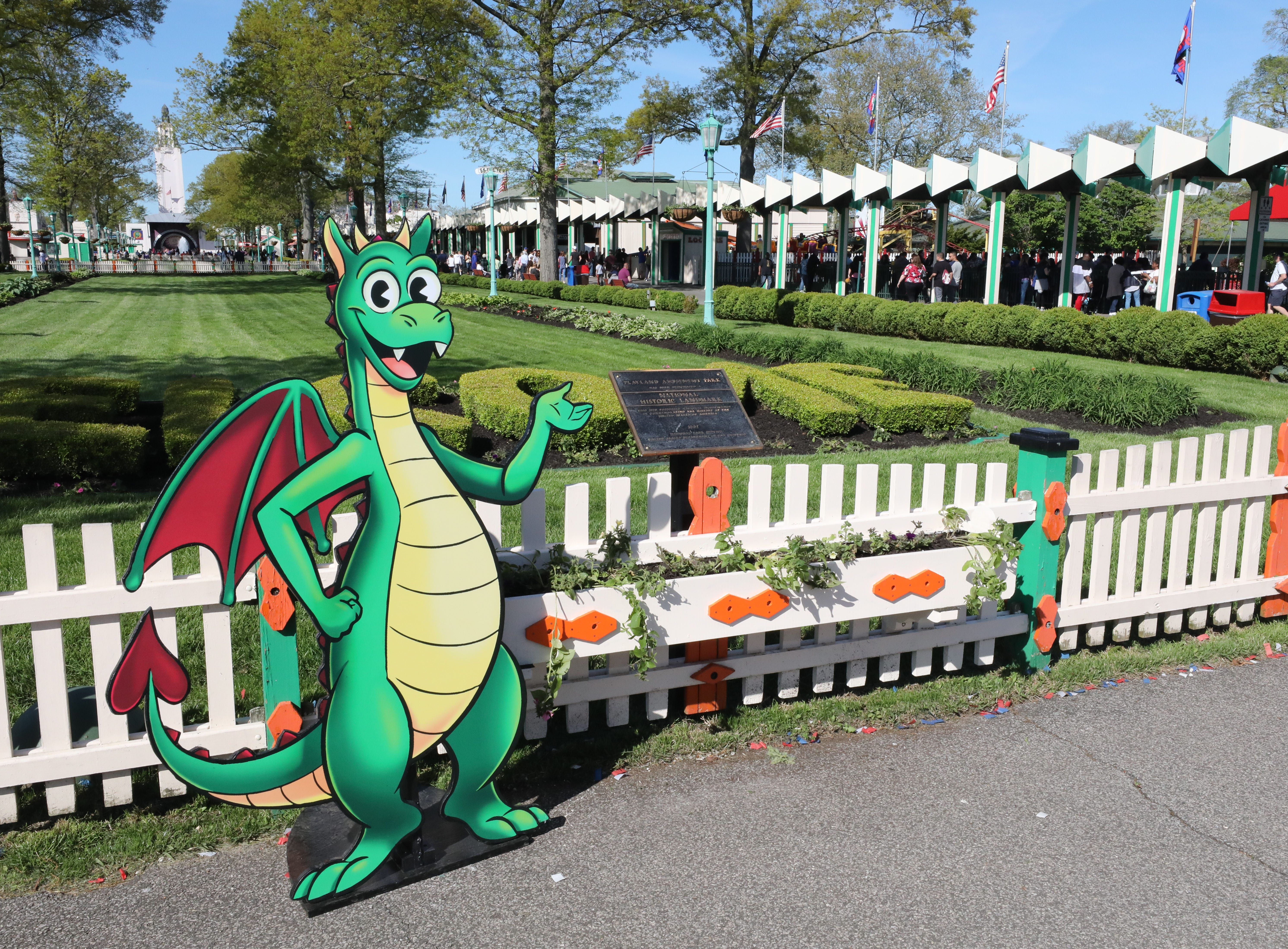 The Hey Coaster dragon mascot greets guests during opening day at Playland in Rye, May 11, 2019.