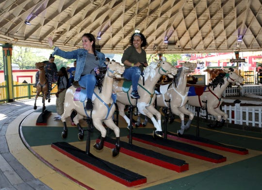 Riders ride the Derby Racer during opening day at Playland in Rye, May 11, 2019.