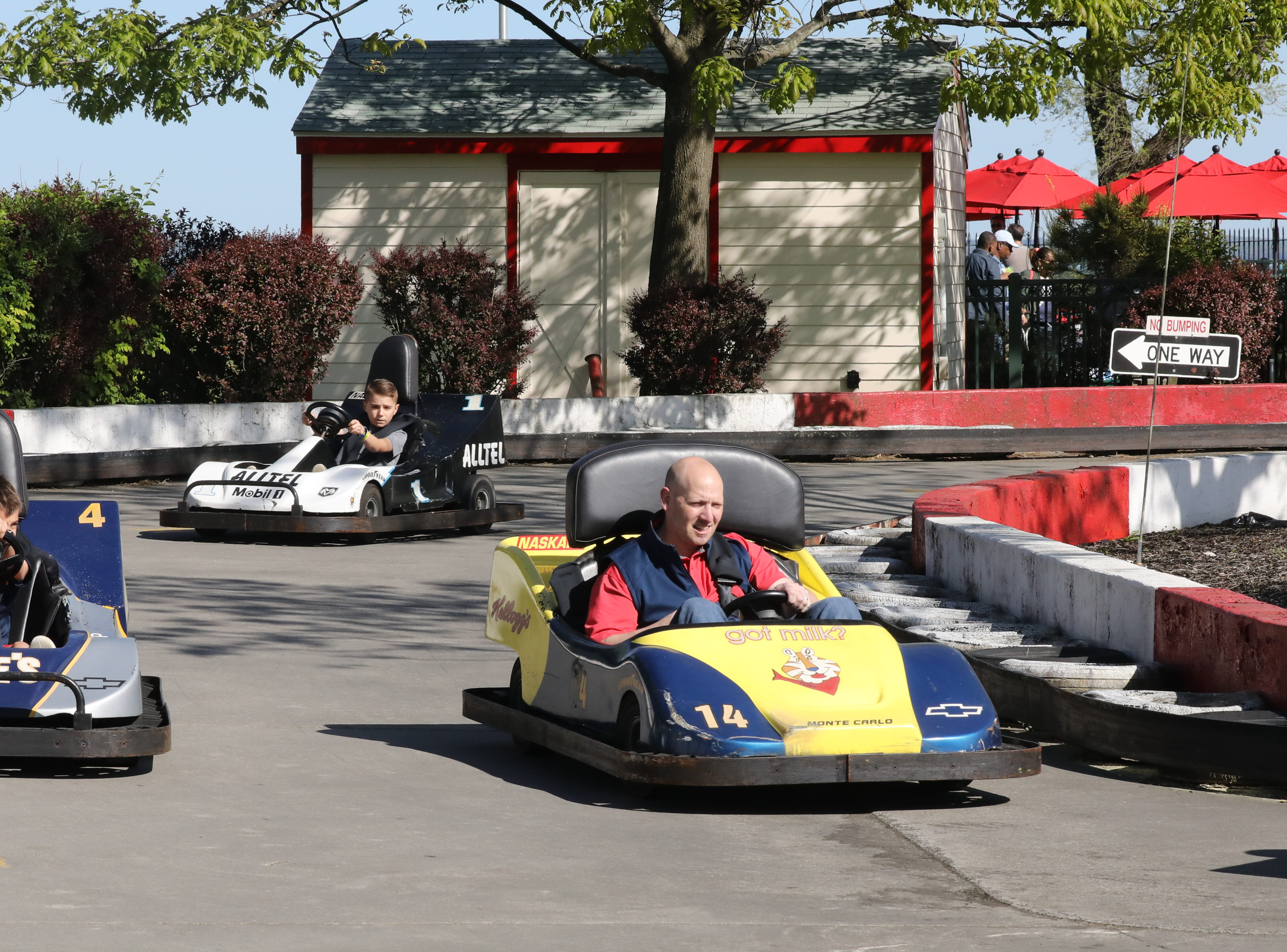 Riders on the go-karts enjoy the beautiful weather during opening day at Playland in Rye, May 11, 2019.