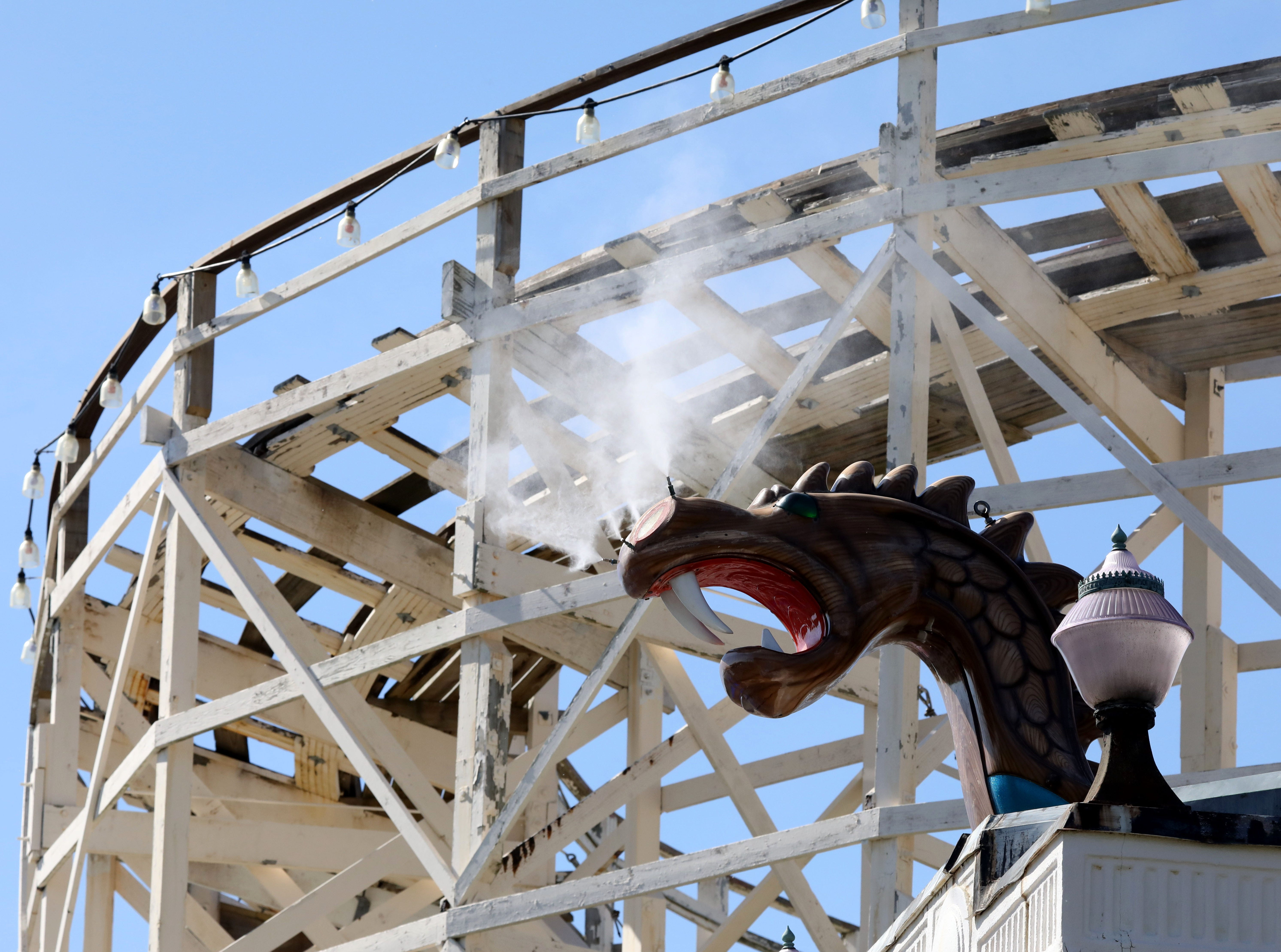 A dragon snorts out steam in front of the Dragon Coaster during opening day at Playland in Rye, May 11, 2019.