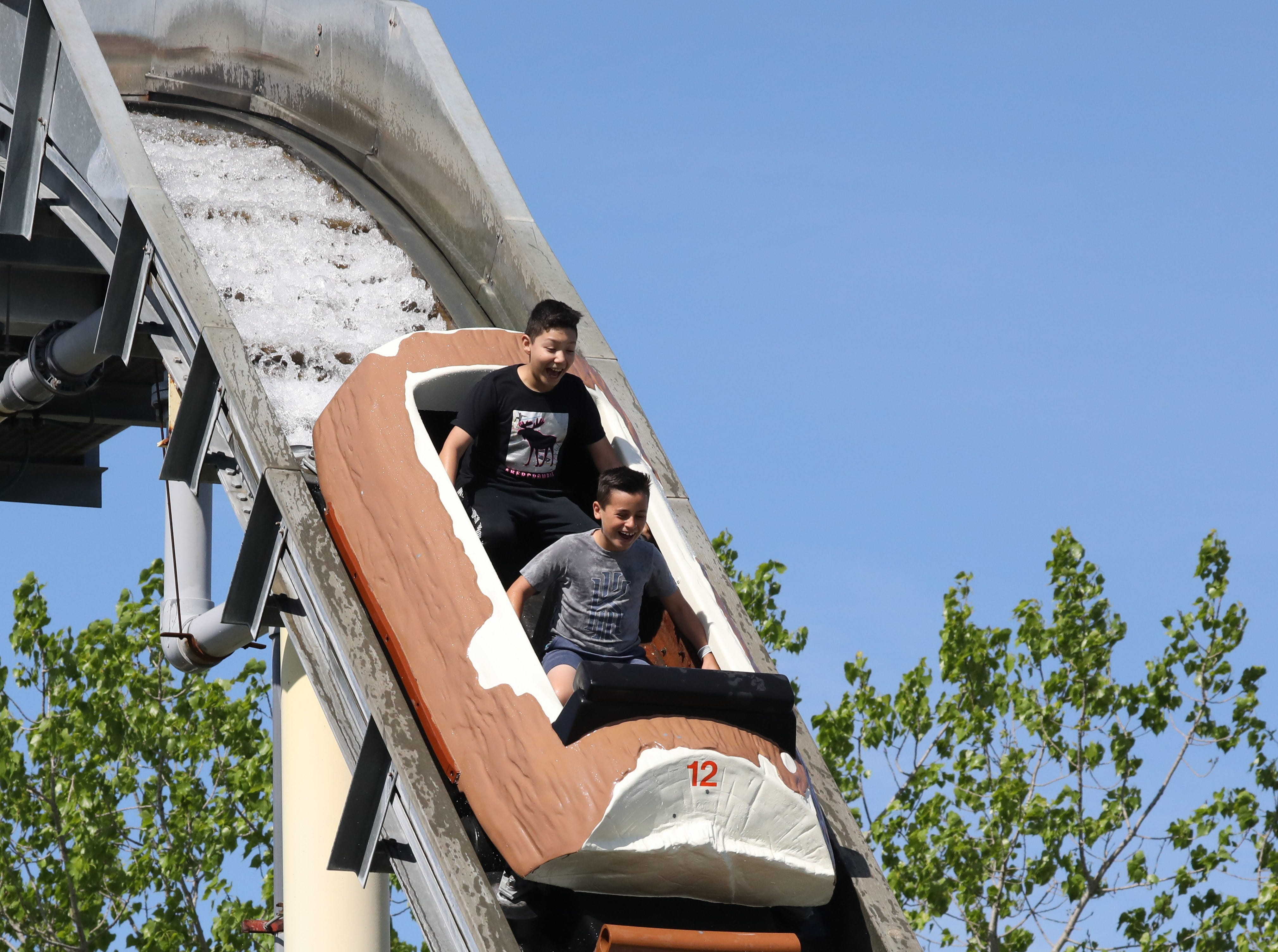 Children enjoy the Log Flume during opening day at Playland in Rye, May 11, 2019.
