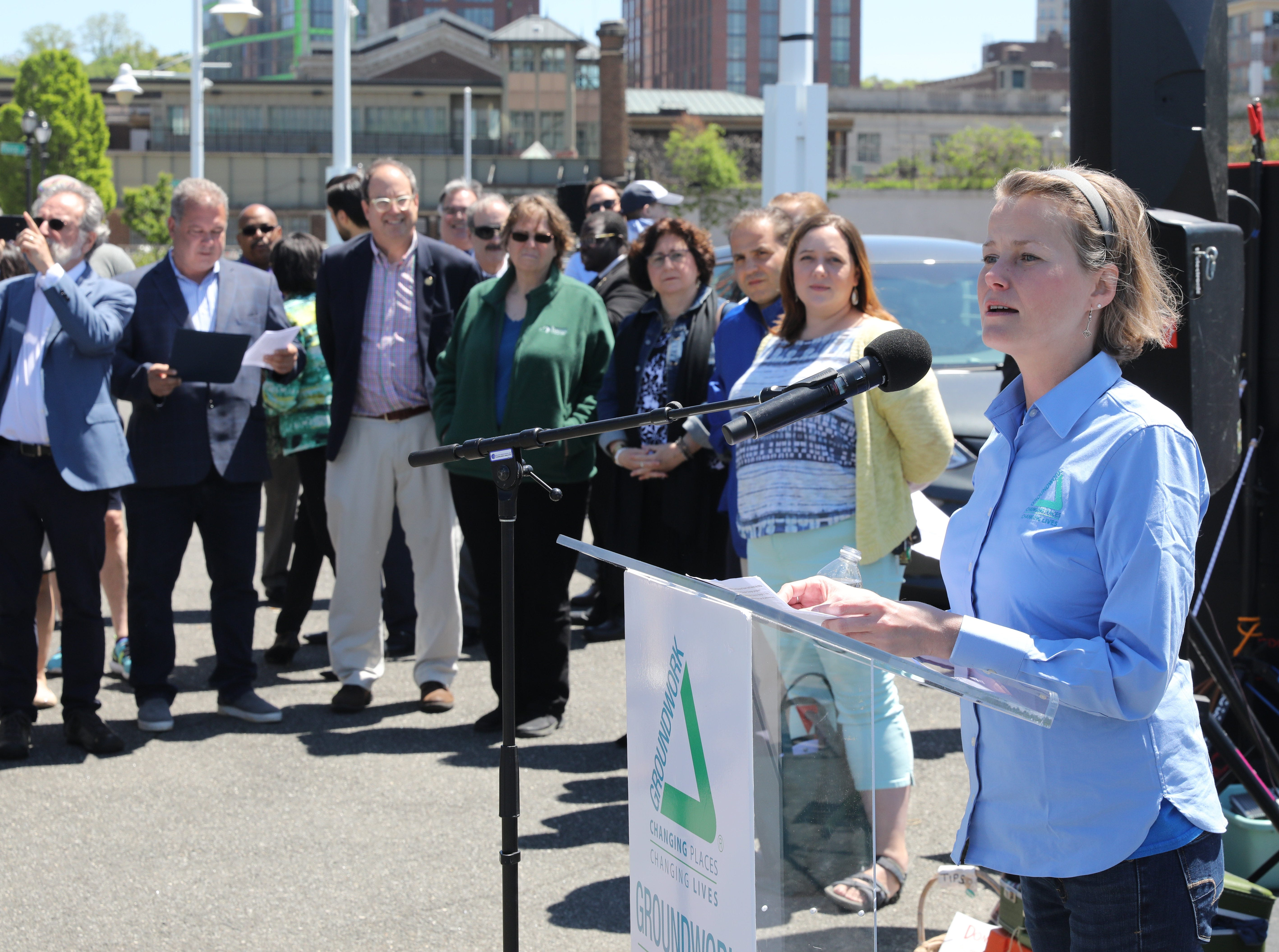 Brigitte Griswold, the executive director of Groundwork Hudson Valley, welcomes the crowd to the Science Barge, as it enjoys its 11th annual opening on the Hudson River in Yonkers, May 11, 2019. The floating environmental education center has undergone an almost $1million enhancement, completed over the past two years.