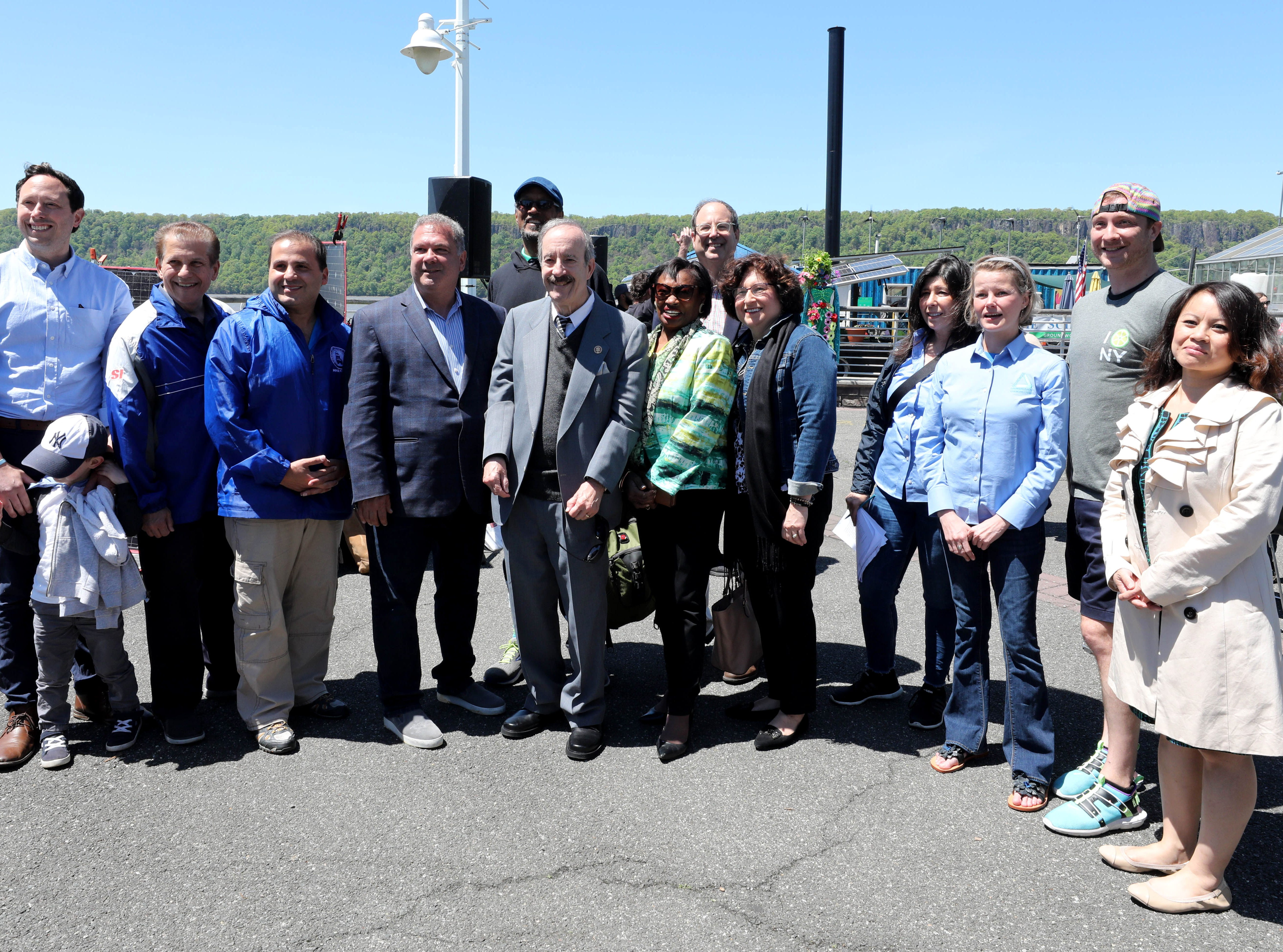 The group of guests and politicians pose for a photo during the 11th annual opening of the Science Barge  on the Hudson River in Yonkers, May 11, 2019. The floating environmental education center has undergone an almost $1million enhancement, completed over the past two years.