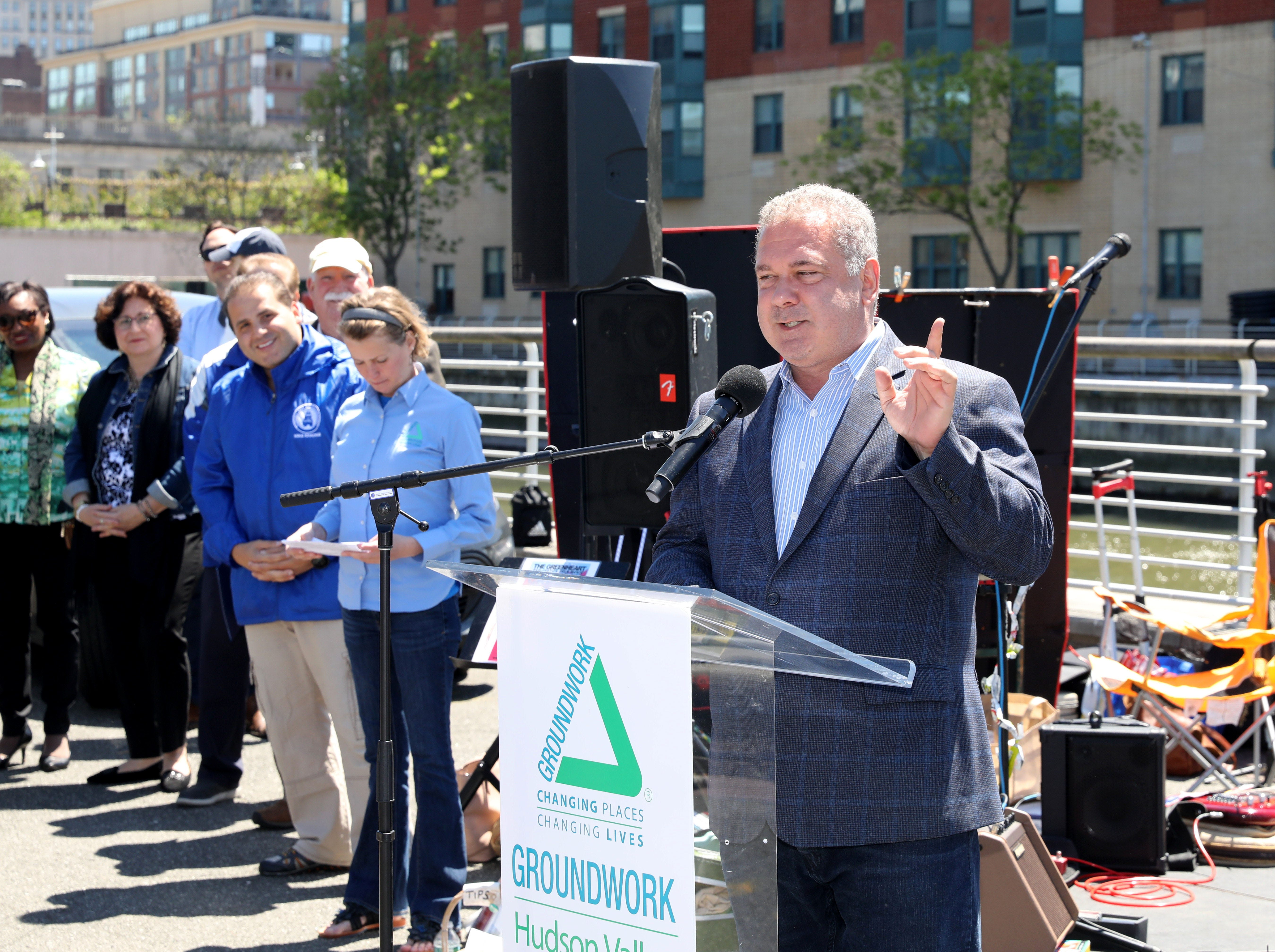 Yonkers Mayor Mike Spano welcomes the crowd to the Science Barge, as it enjoys its 11th annual opening on the Hudson River in Yonkers, May 11, 2019. The floating environmental education center has undergone an almost $1million enhancement, completed over the past two years.