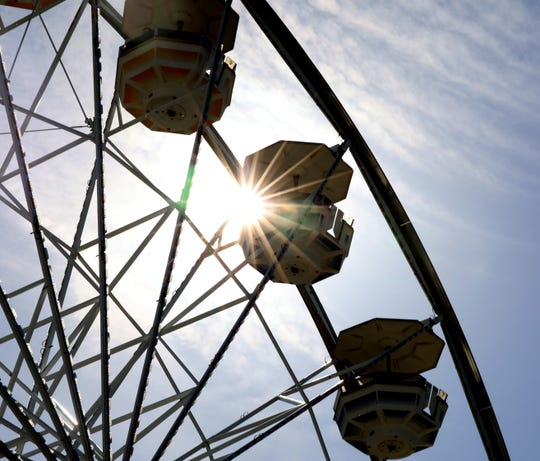 The sun shines through the Gondola Wheel during opening day at Playland in Rye, May 11, 2019.